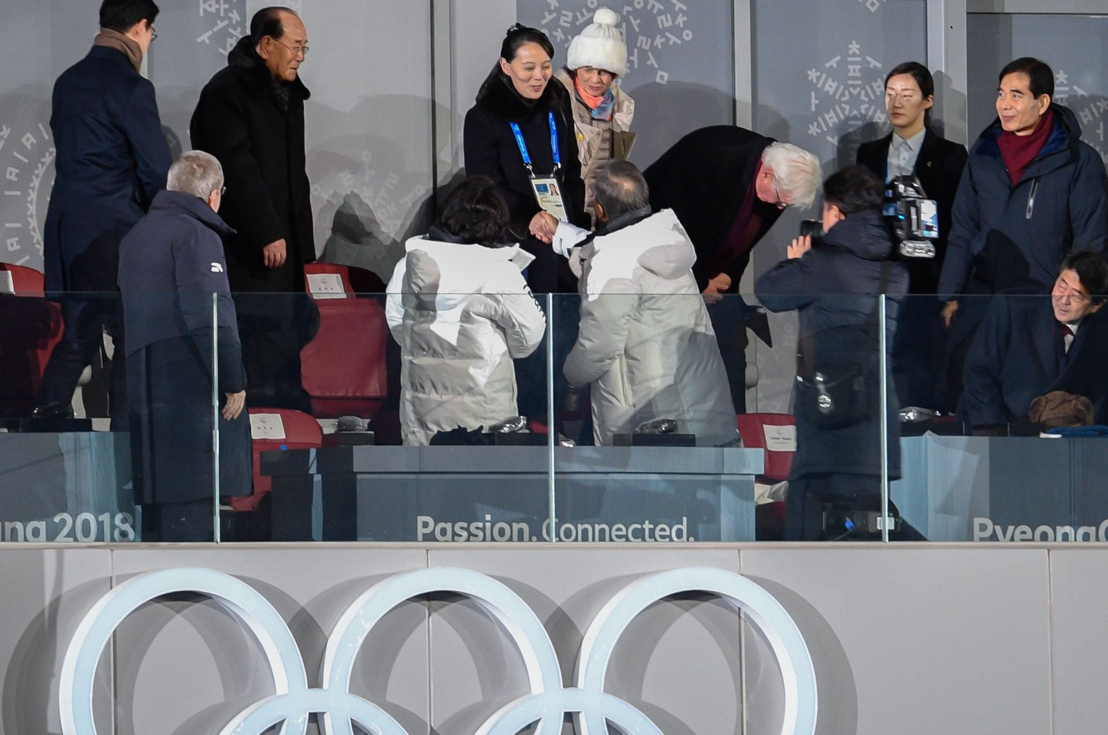 North Korea's Kim Jong Un's sister Kim Yo Jong shakes hand with South Korea's president Moon Jae-In during the opening ceremony of the Pyeongchang 2018 Winter Olympic games at the Pyeongchang stadium on Feb. 9, 2018. (AFP Photo)