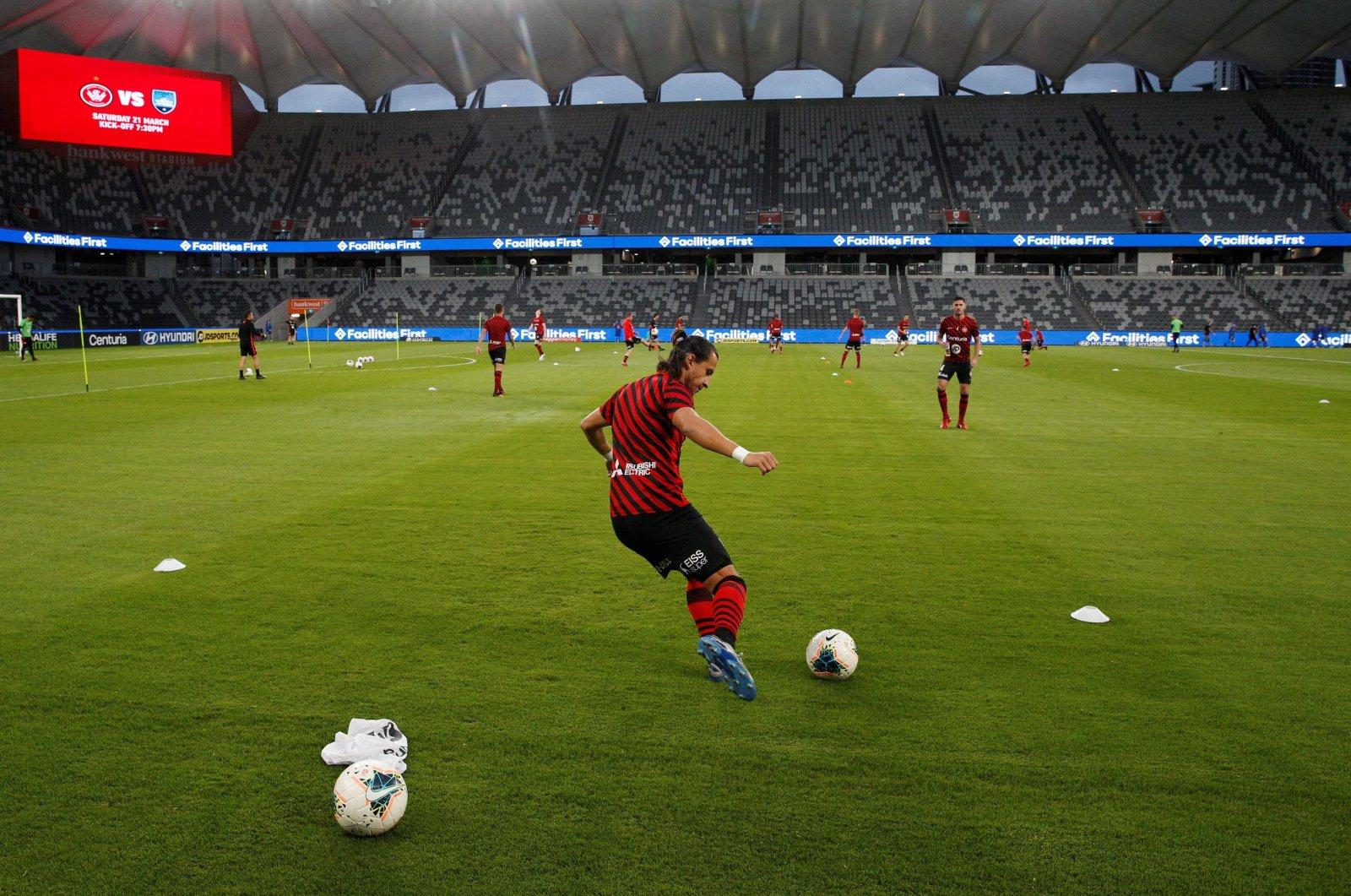 Western Sydney Wanderers' Daniel Georgievski (C) warms up in Bankwest Stadium, Sydney, Australia, March 21, 2020. (AFP Photo)