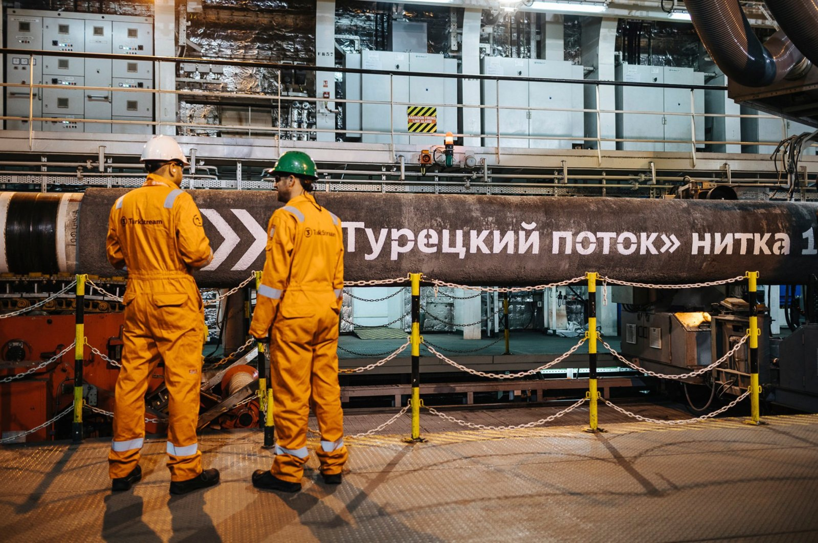 Workers are seen in front of pipes to be laid on the Black Sea seabed by the vessel Pioneering Spirit as part of the TurkStream gas pipeline project, Feb. 5, 2018. (AA Photo)