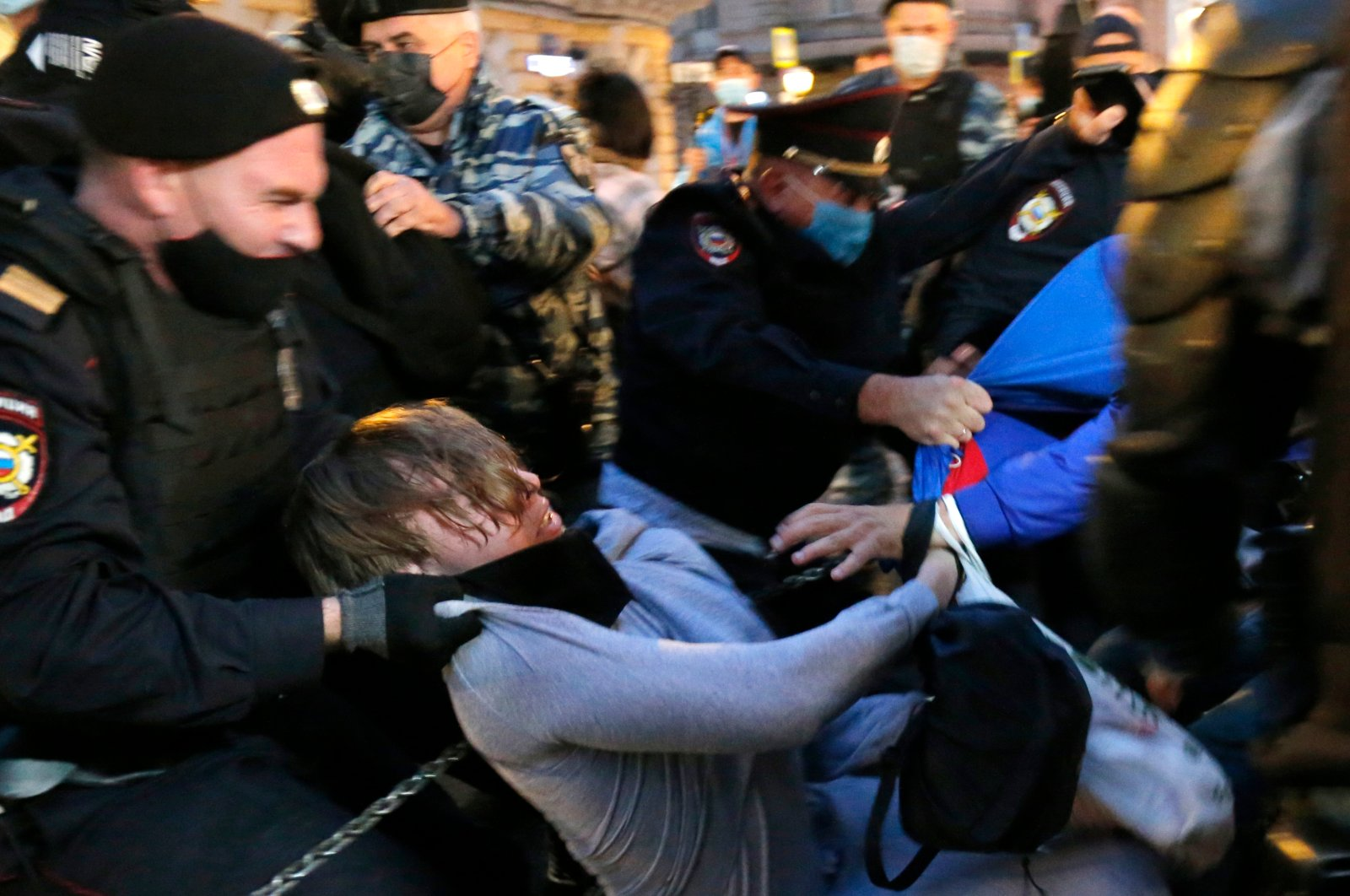 Police officers detain a protester during a rally to cancel the results of voting on amendments to the Constitution in Pushkin Square in Moscow, Russia, July 15, 2020. (AP Photo)