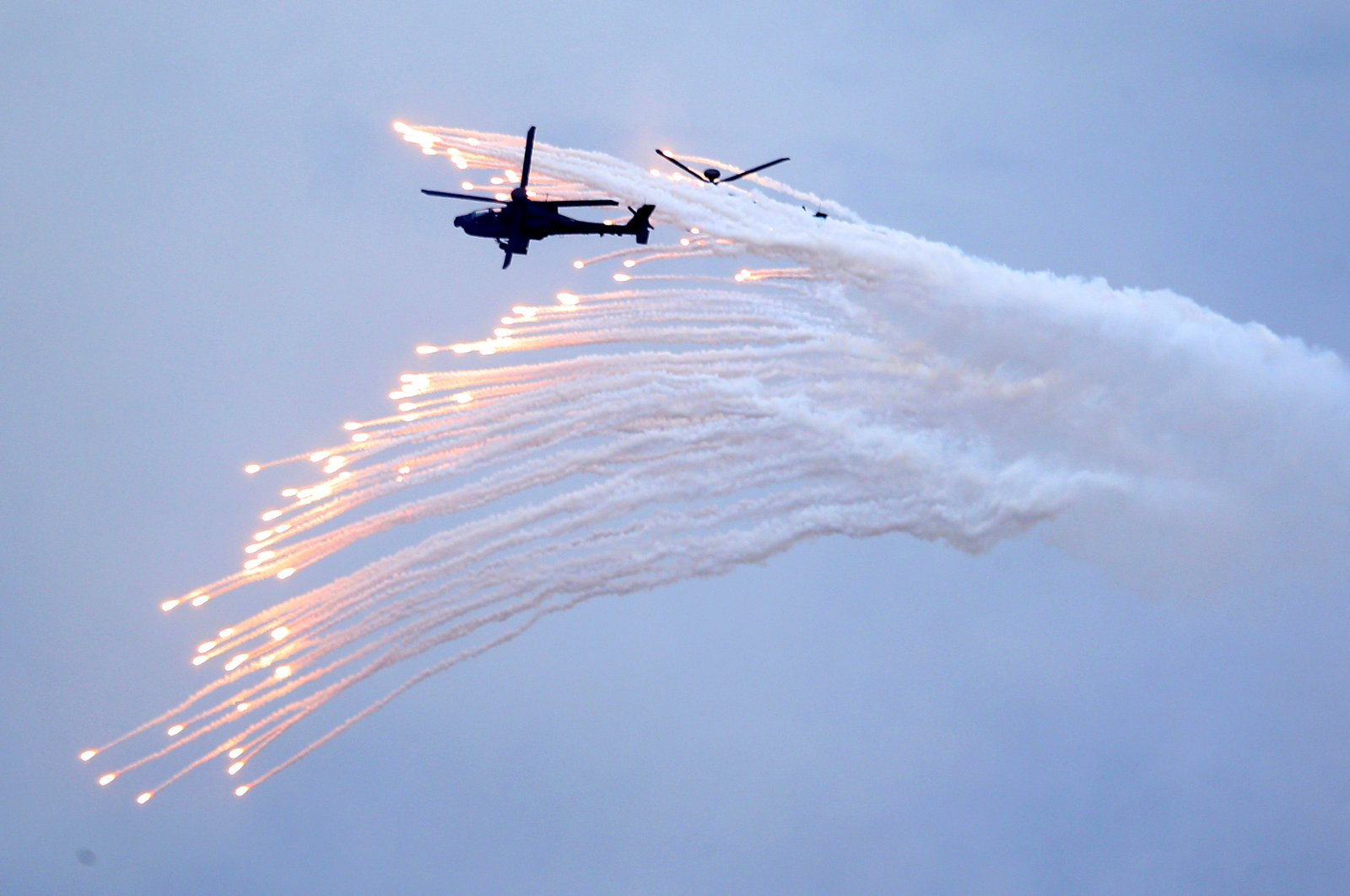 Taiwan's AH-64E Apache attack helicopter launches flares during the 36th Han Kung military exercises in Taichung City, central Taiwan, July 16, 2020. (AP Photo)