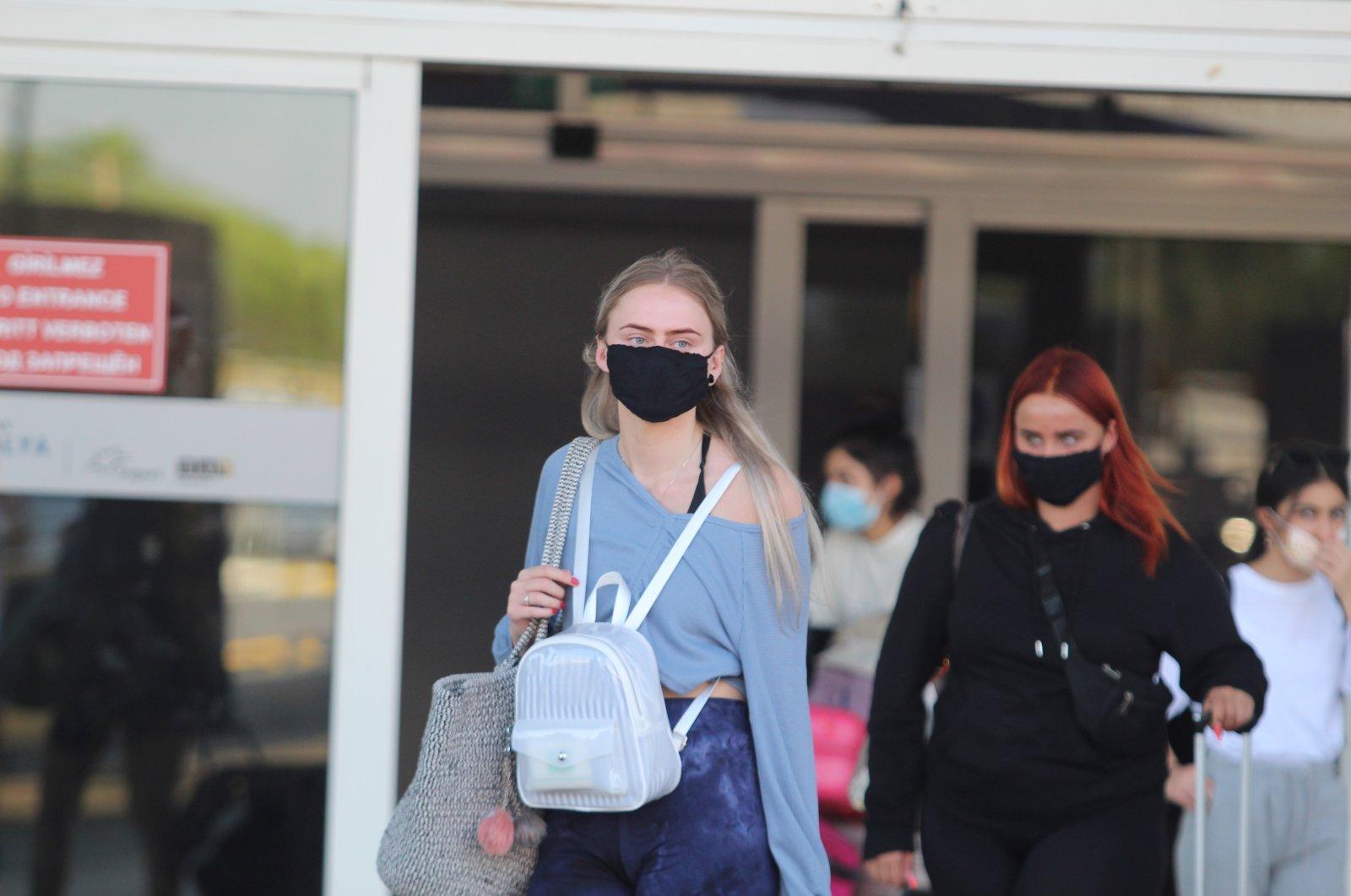 Passengers of the first charter plane from the U.K. following the coronavirus lockdowns arrive at Antalya Airport, Antalya, Turkey, July 15, 2020. (IHA Photo)