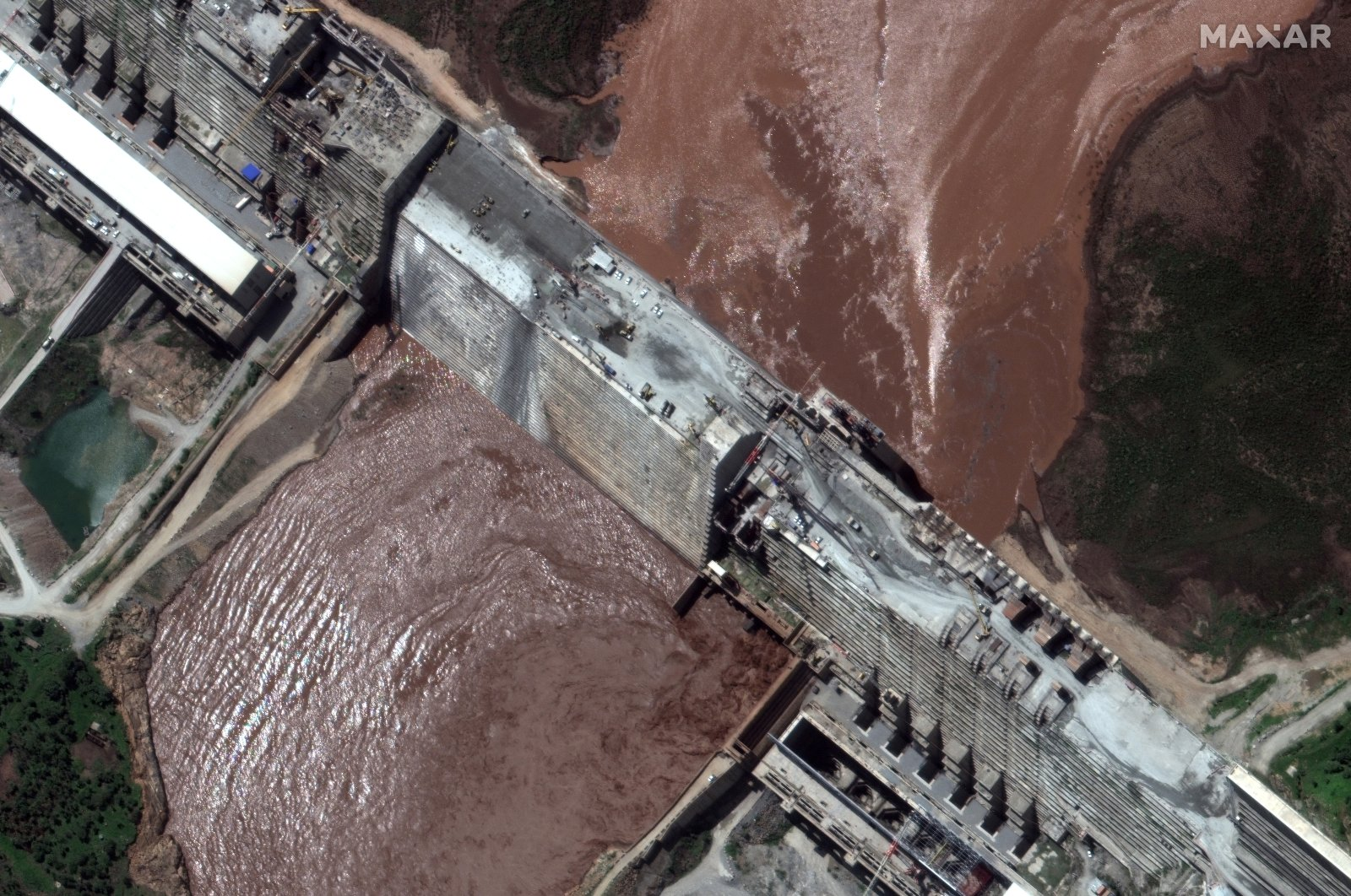 A handout satellite image shows a closeup view of the Grand Ethiopian Renaissance Dam (GERD) and the Blue Nile River, Ethiopia, June 26, 2020. (REUTERS Photo)