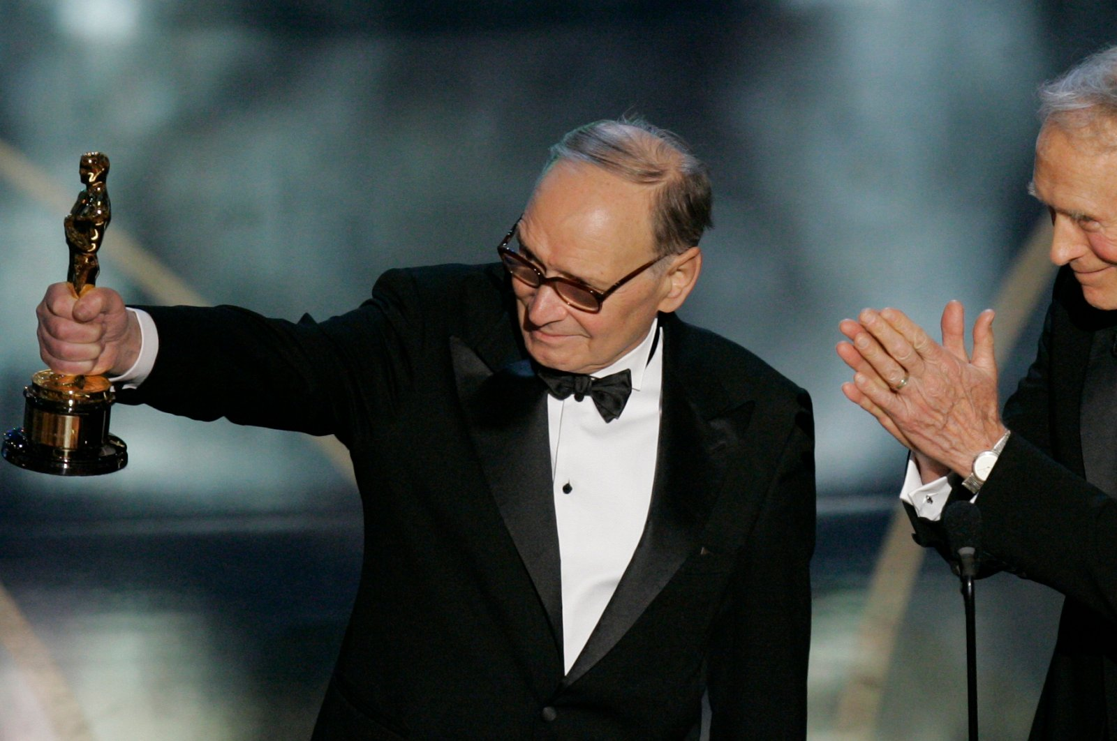 Italian composer Ennio Morricone (L), accepts an honorary Oscar for his contributions to the art of film music as director Clint Eastwood looks on during the 79th Academy Awards telecast in Los Angeles on Feb. 25, 2007. (AP Photo)