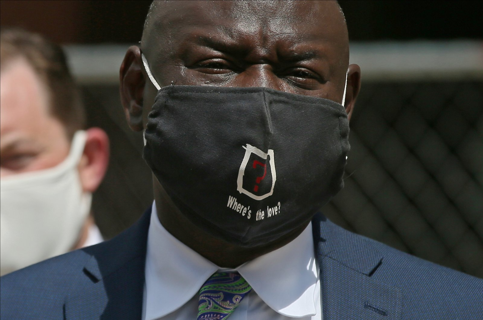 """Civil rights attorney Ben Crump wears a face mask with the words """"Where's the love?"""" after announcing the filing of a civil lawsuit against the city of Minneapolis and the officers involved in the death of George Floyd, Minneapolis, Minnesota, U.S., July 15, 2020. (AP Photo)"""