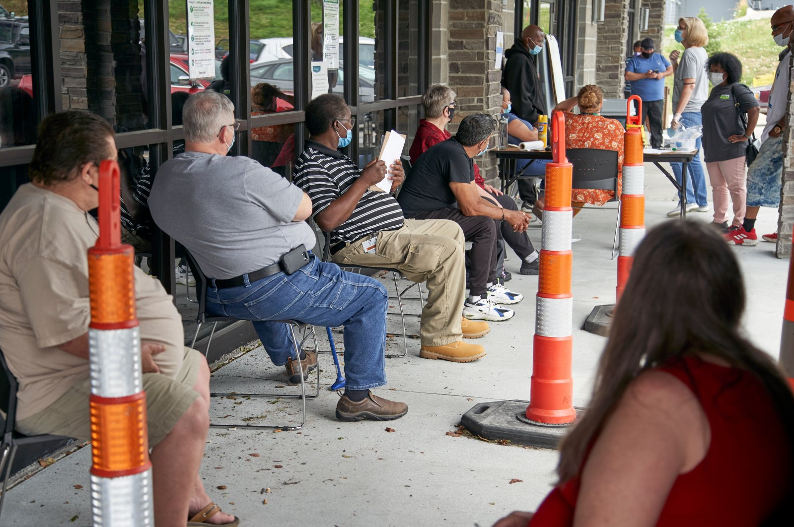 Job seekers exercise social distancing as they wait to be called into the Heartland Workforce Solutions office in Omaha, Nebraska, U.S., July 15, 2020. (AP Photo)