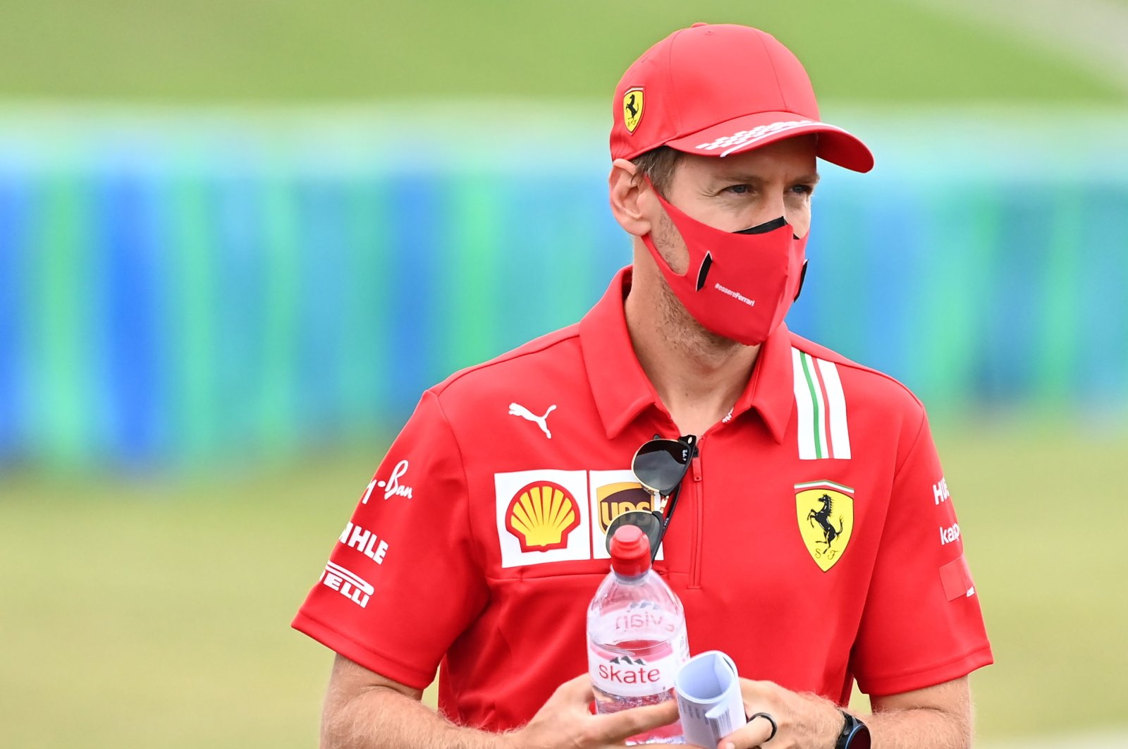 Ferrari's Sebastian Vettel walks along the race track ahead of the F1 Hungarian GP, Budapest, Hungary, July 16, 2020. (AFP Photo)