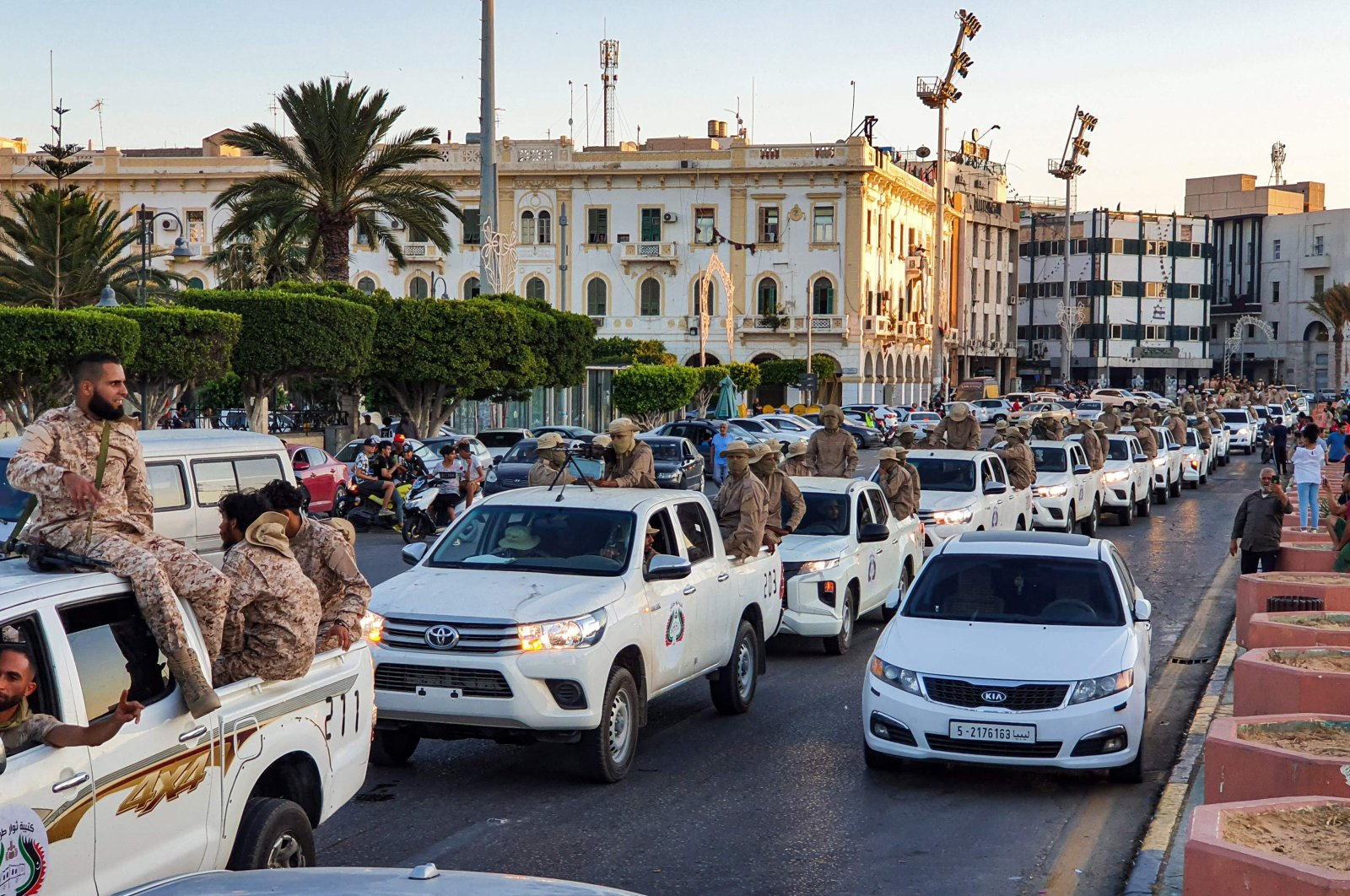 "Vehicles of the ""Tripoli Brigade"", a group loyal to the UN-recognised Government of National Accord (GNA), parade through the Martyrs' Square at the centre of the GNA-held Libyan capital Tripoli, July 10, 2020. (AFP)"