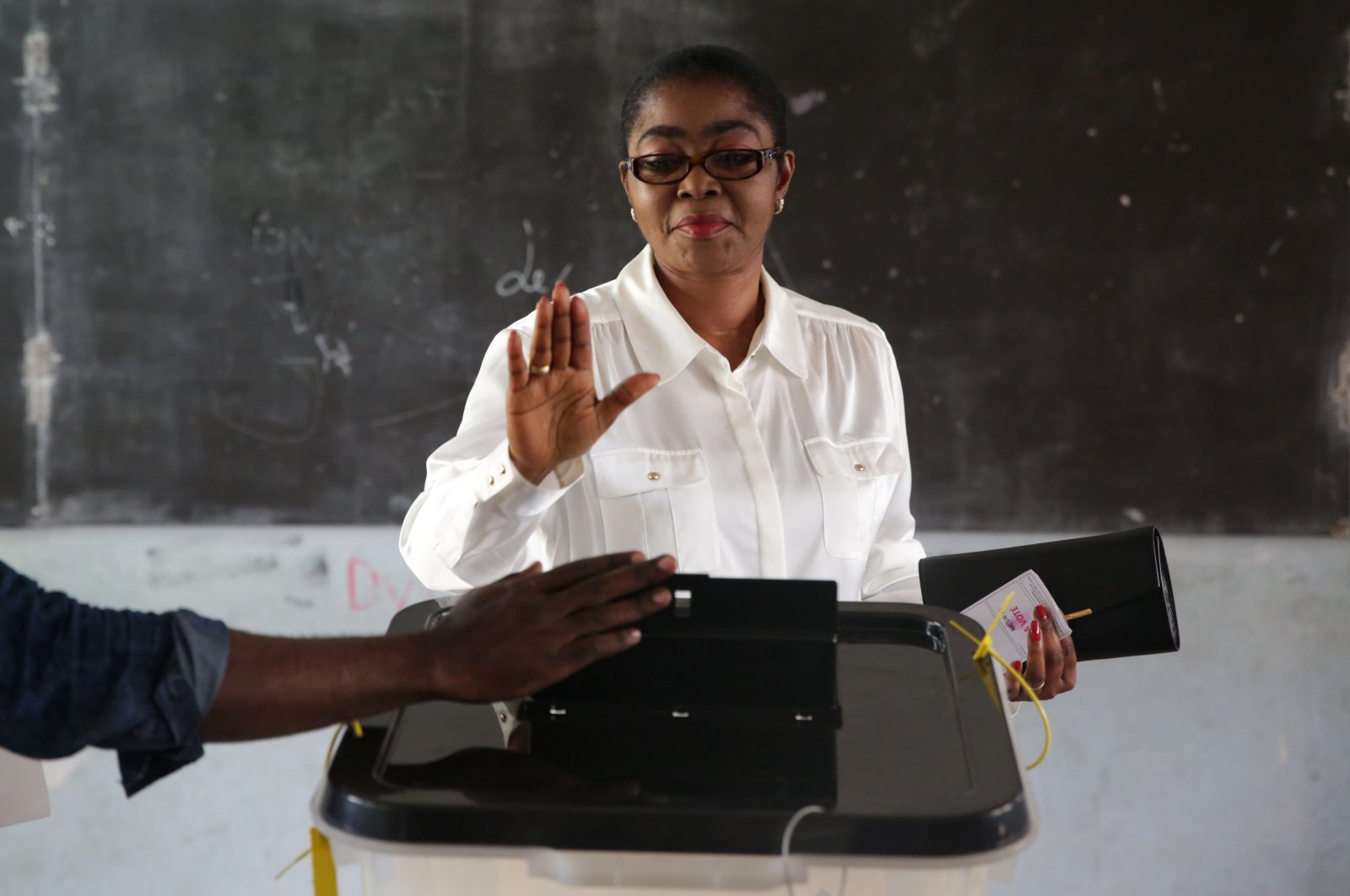 Mayor of Libreville and Gabonese Democratic Party (PDG) candidate for the local elections, Rose Christiane Ossouka Raponda, casts her vote at a polling station in Libreville, during the first round of the country's legislative and municipal elections, Oct. 6, 2018. (AFP)