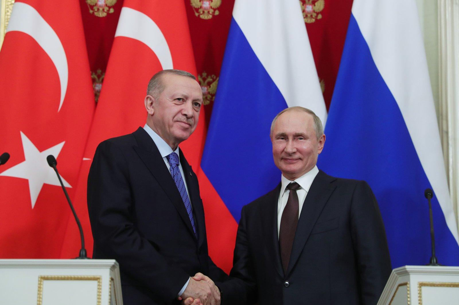 President Recep Tayyip Erdoğan shakes hand with Russian President Vladimir Putin following a joint press conference in Moscow, March 6, 2020. (AA)
