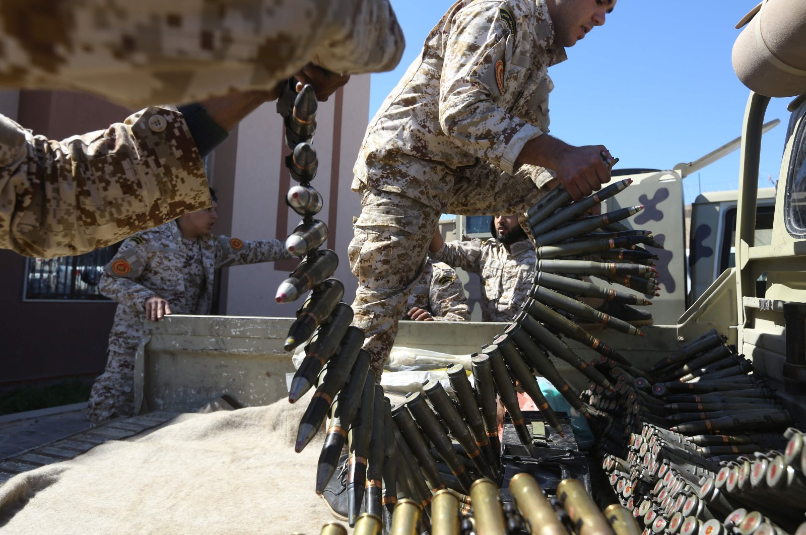 Fighters from a Misrata armed group loyal to the internationally recognised Libyan Government of National Accord (GNA) prepare their ammunition before heading to the frontline as battles against Khalifa Haftar, in Tripoli, April 8, 2019. (AFP)