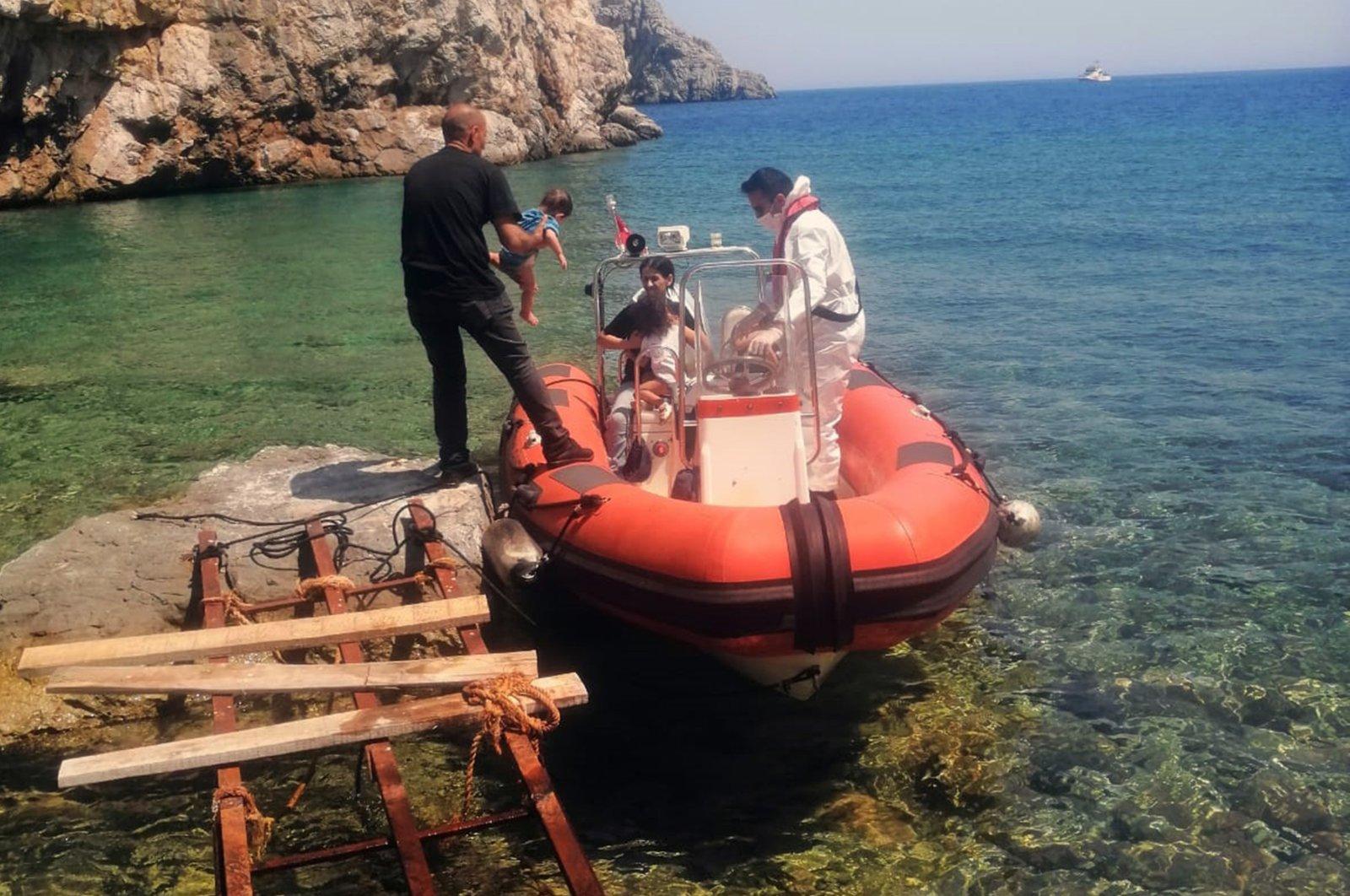 Eight migrants were rescued by Turkish coast guards in Çiftlik Bay of Marmaris district in southwestern Muğla province, Turkey, July 16, 2020. (IHA Photo)