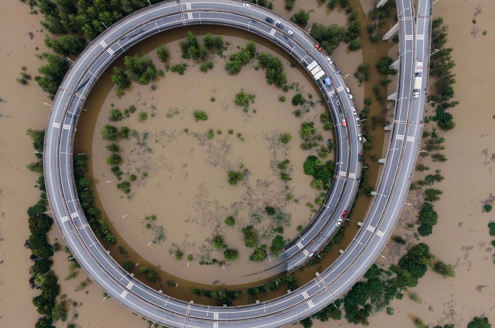 This aerial view shows a bridge leading to the inundated Tianxingzhou island, which is set to be a flood flowing zone to relieve pressure from the high level of water in the Yangtze in Wuhan, central Hubei province, China, July 13, 2020. (AFP Photo)