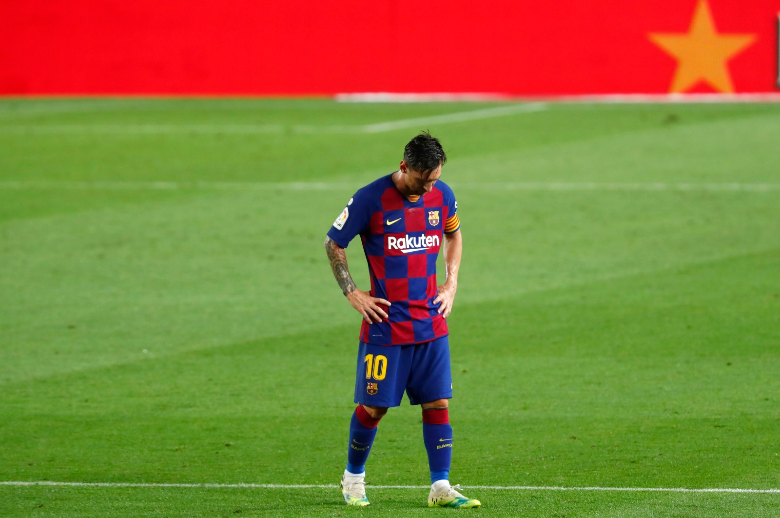 Barcelona's Lionel Messi looks down dejected as he walks after the end of the match against Osasuna, Barcelona, Spain, July 16, 2020. (AP Photo)