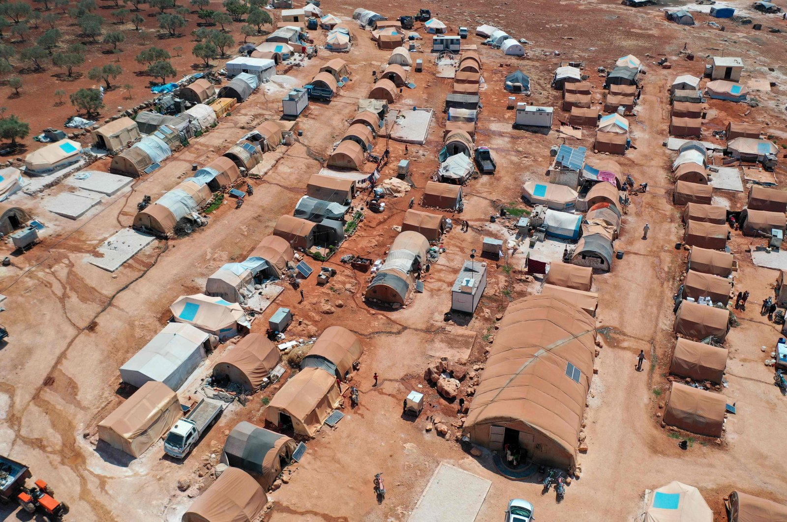 An aerial view of a camp for displaced Syrians from Idlib and Aleppo provinces, near the town of Maaret Misrin, northwestern Idlib province, Syria, July 11, 2020. (AFP Photo)