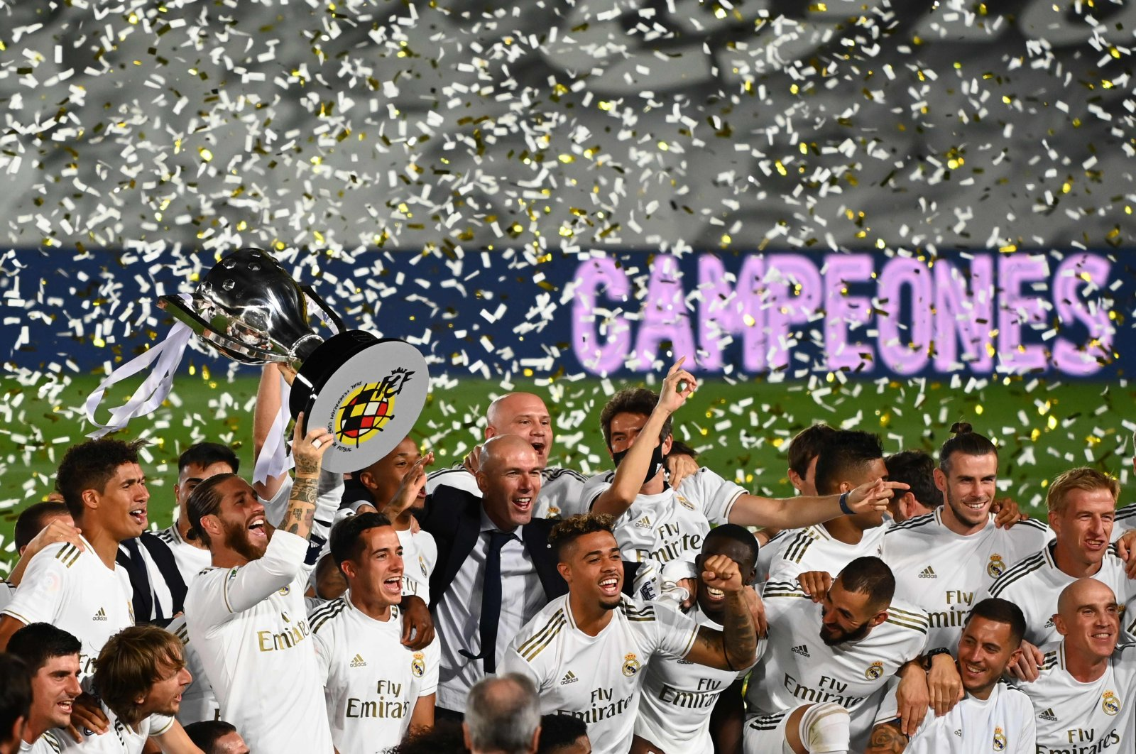 Real Madrid's players celebrate winning the La Liga title, in Madrid, Spain, July 16, 2020. (AFP Photo)
