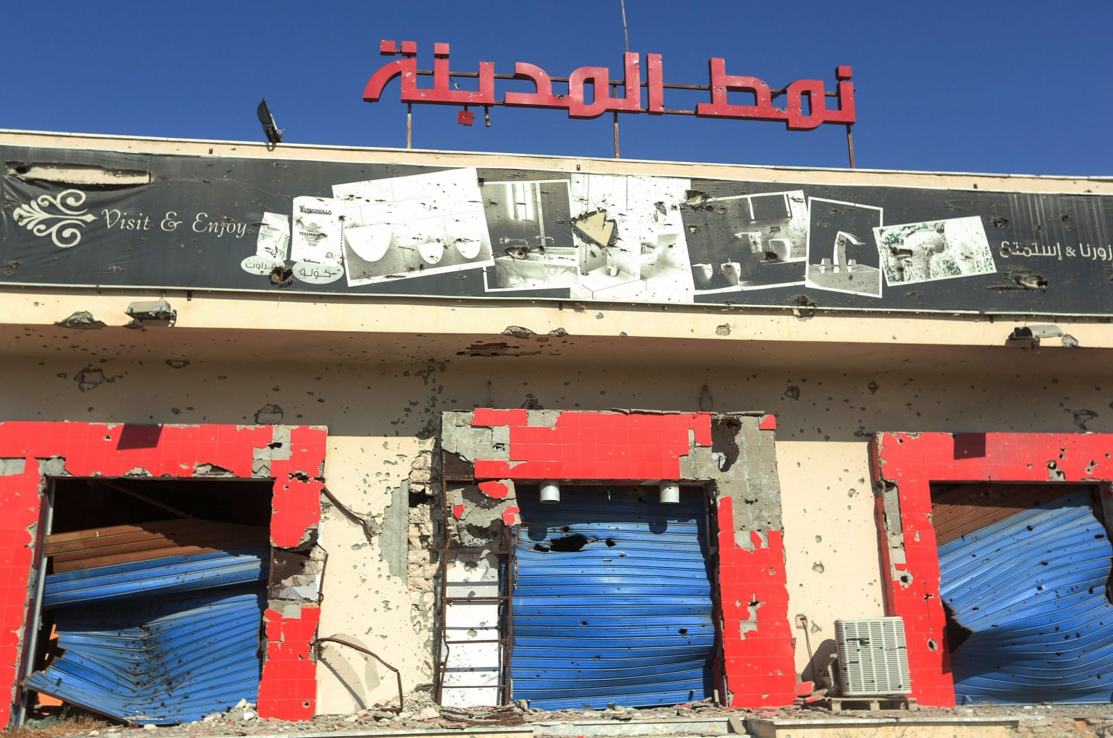 A shop, damaged during the 14 months of fighting between the U.N.-recognized Government of National Union (GNA) and putschist Gen. Khalifa Haftar, in a southern neighborhood in the capital Tripoli, July 9, 2020. (AFP Photo)