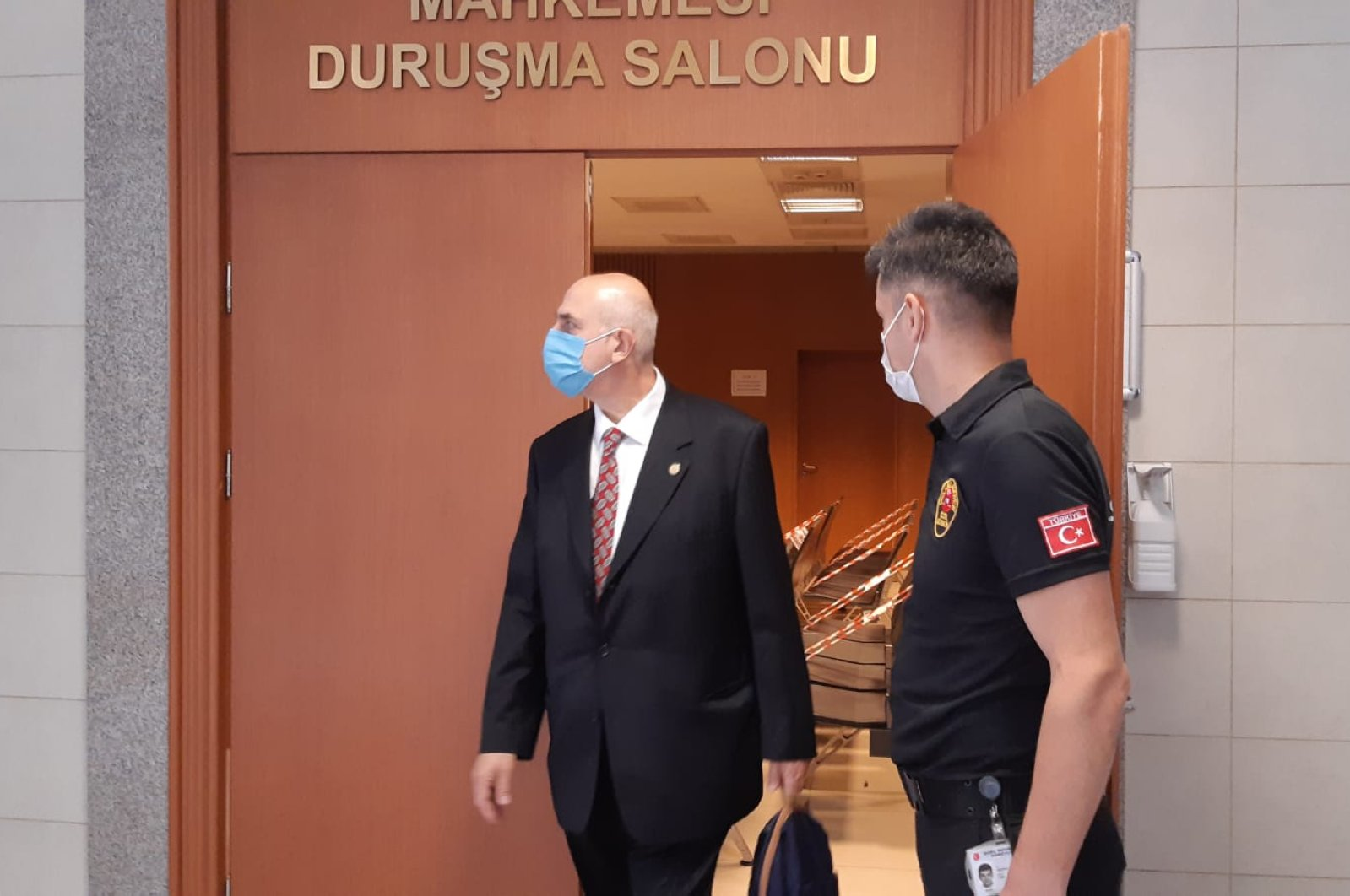 Nazmi Mete Cantürk (L) leaves the courtroom, in Istanbul, Turkey, July 17, 2020. (AA Photo)