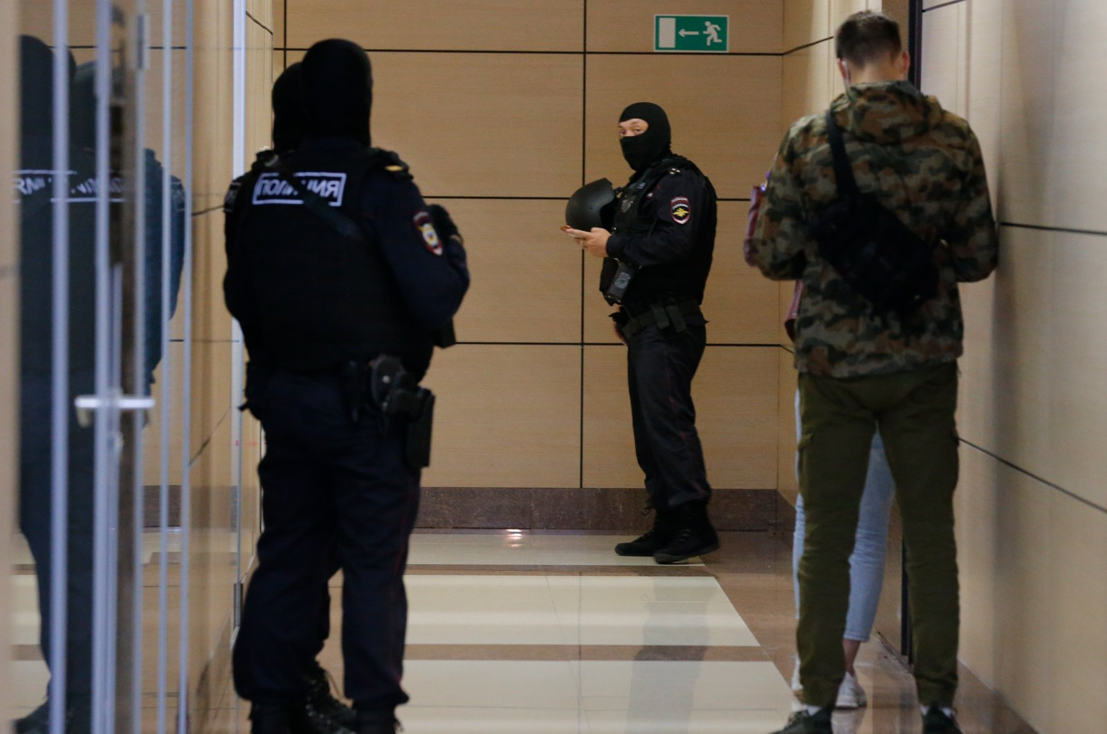 Police raid the offices of Alexei Navalny's Foundation for Fighting Corruption in Moscow, Russia, Friday, July 17, 2020. Opposition leader Navalny sees the move as politically motivated.(AP Photo)