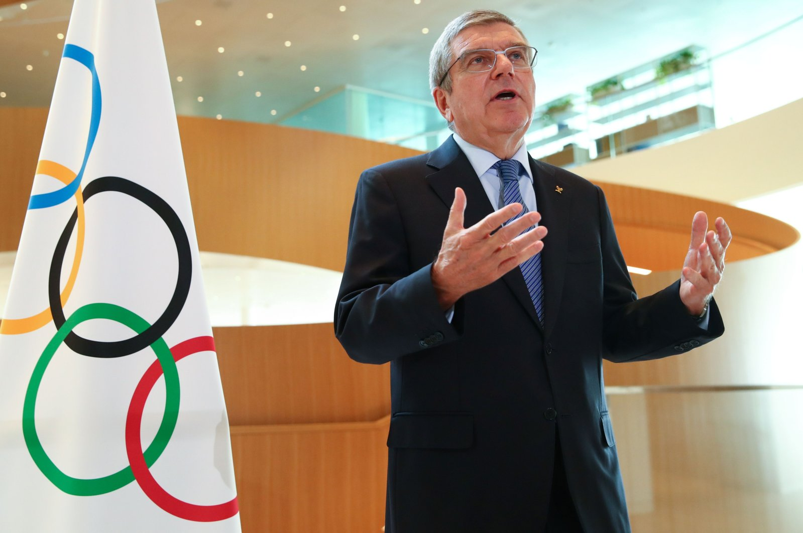 International Olympic Committee (IOC) President Thomas Bach gestures as he speaks during an interview after the historic decision to postpone the 2020 Tokyo Olympic Games due to the coronavirus pandemic, in Lausanne, Switzerland, March 25, 2020. (AFP Photo)
