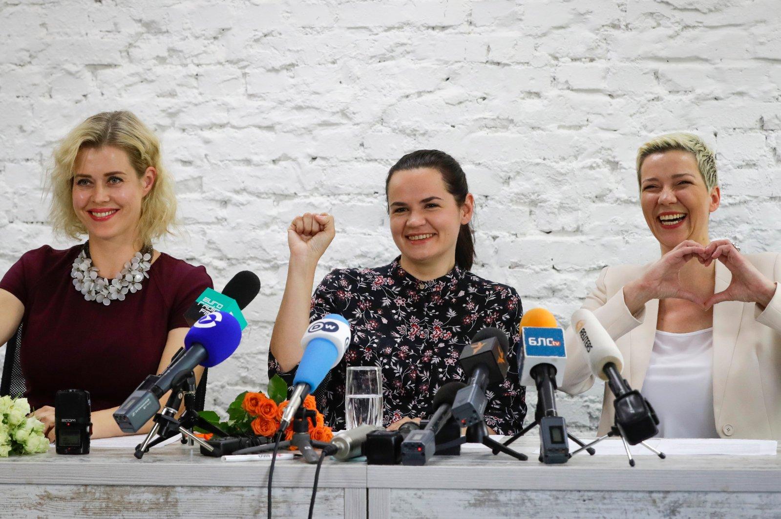 Maria Kolesnikova, a representative of Viktor Babariko (R), Svetlana Tikhanovskaya, candidate for the presidential elections (C), and wife of non-registered candidate Valery Tsepkalo, Veronika Tsepkalo, gestures during a news conference in Minsk, Belarus, July 17, 2020. (AP Photo)