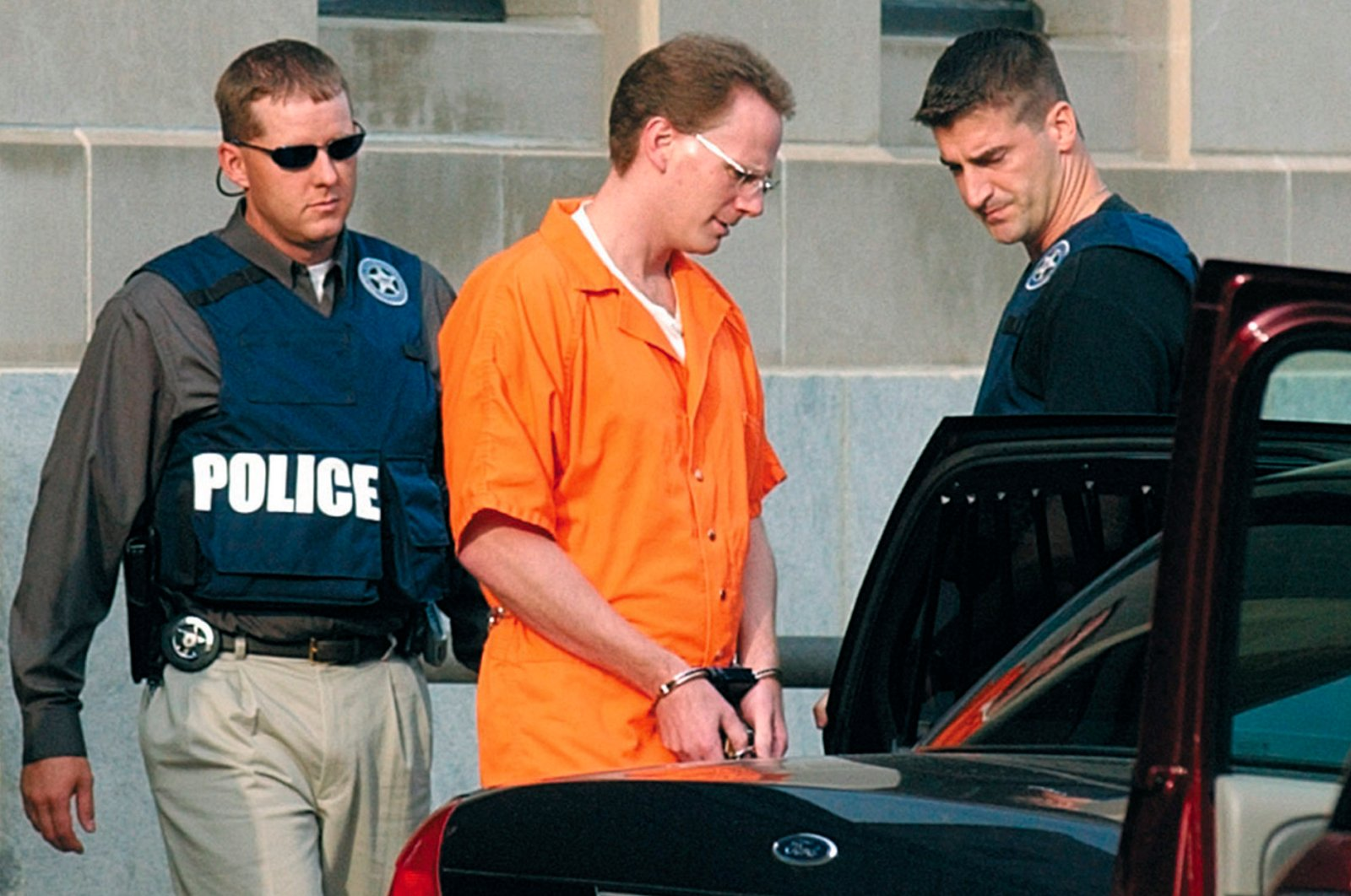 In this Aug. 18, 2004 file photo, Dustin Honken is led by federal marshals to a waiting car after the second day of jury selection in federal court in Sioux City, Iowa. (AP Photo)