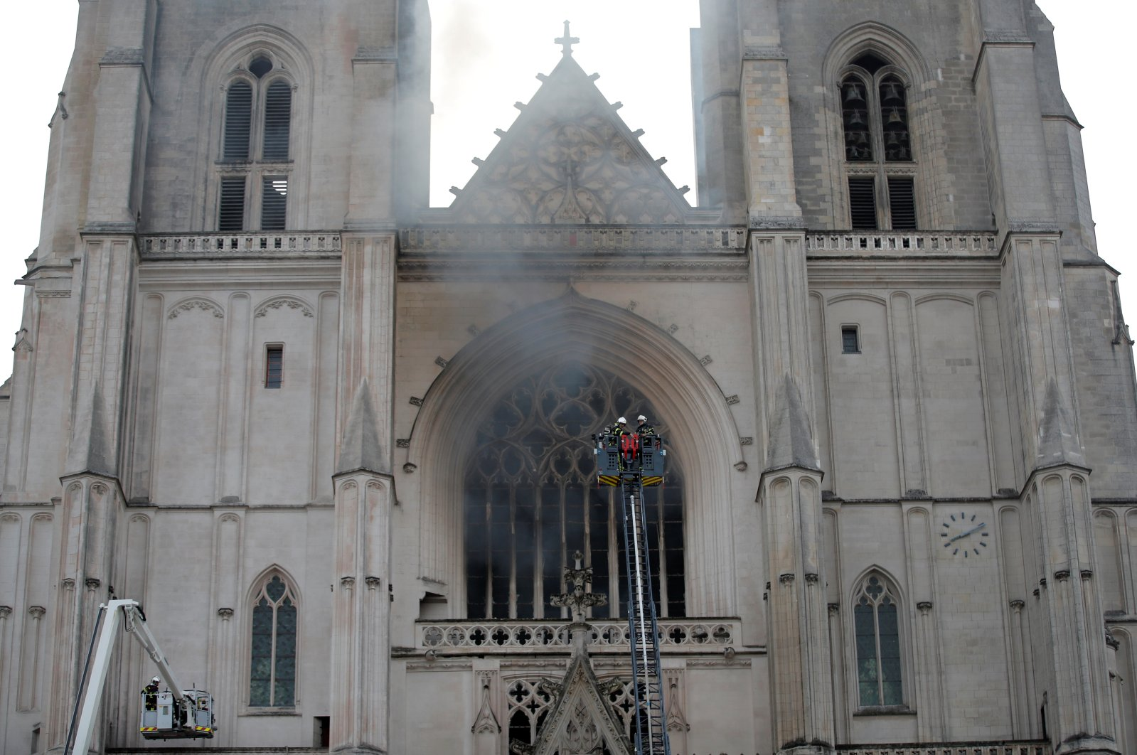 French firefighters battle a blaze at the Cathedral of Saint Pierre and Saint Paul in Nantes, France, July 18, 2020. (Reuters Photo)