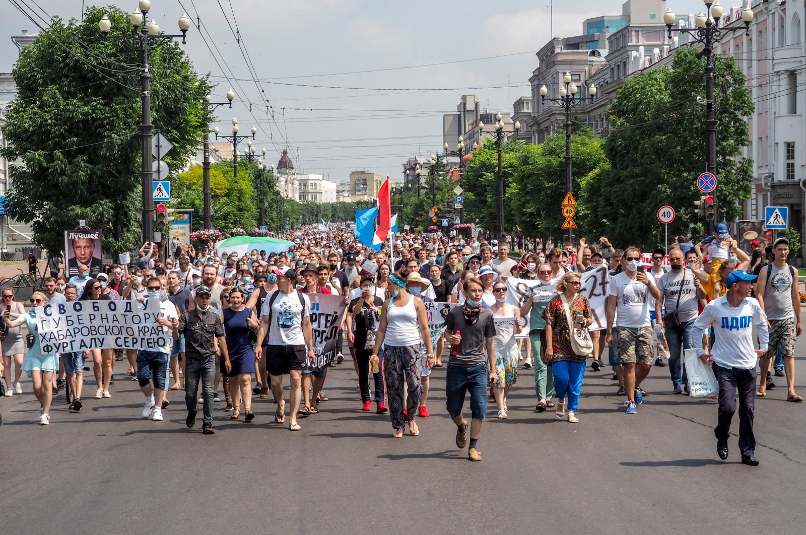 """People hold posters that read: """"Freedom for Khabarovsk region's governor Sergei Furgal"""" during an unsanctioned protest in support of Sergei Furgal, the governor of the Khabarovsk region, in Khabarovsk, 6100 kilometers (3800 miles) east of Moscow, Russia, Saturday, July 18, 2020. (AP Photo)"""