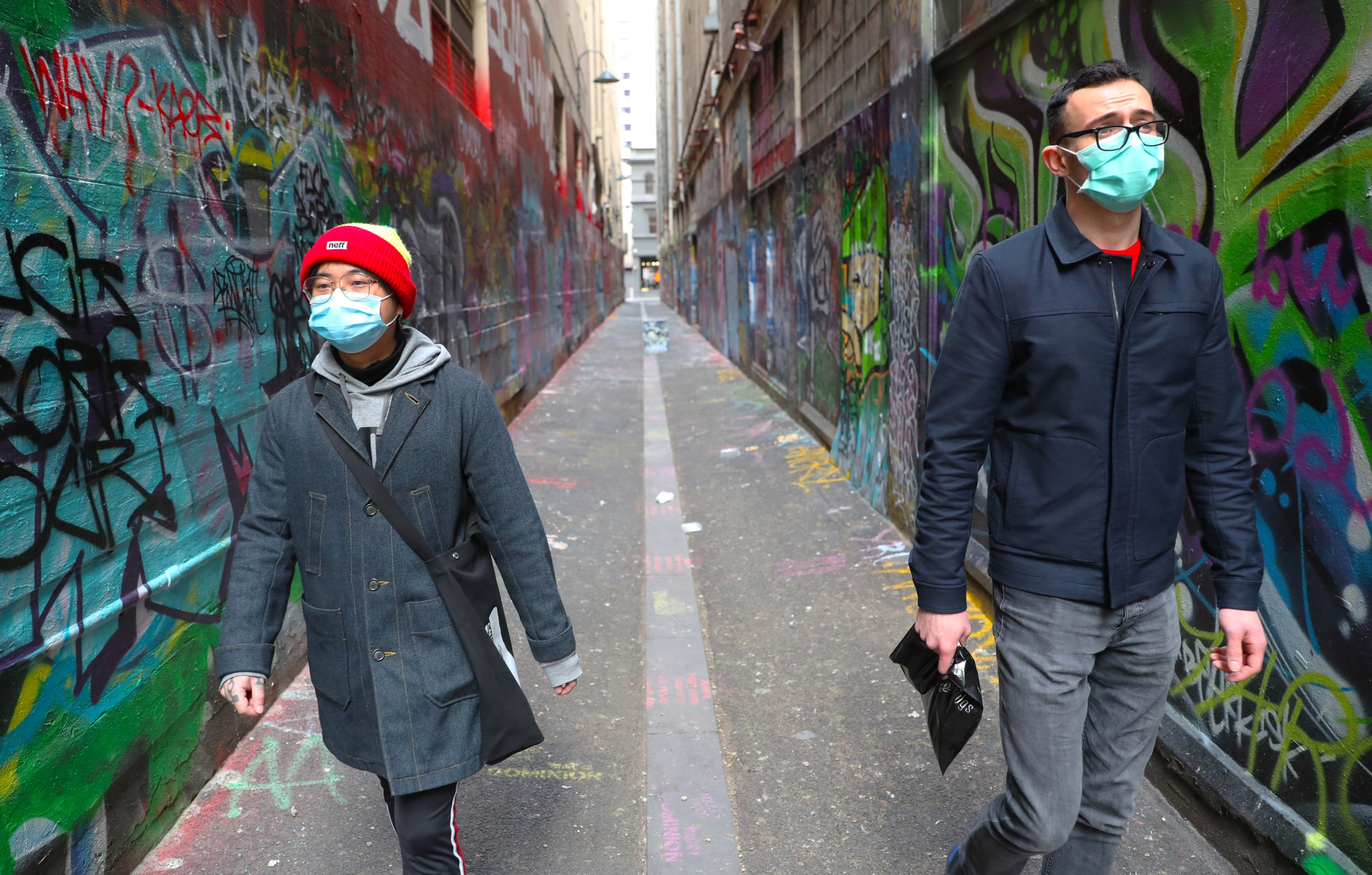 People are seen wearing masks in Union lane in Melbourne, Australia, July 19, 2020. (AAP Image via REUTERS)