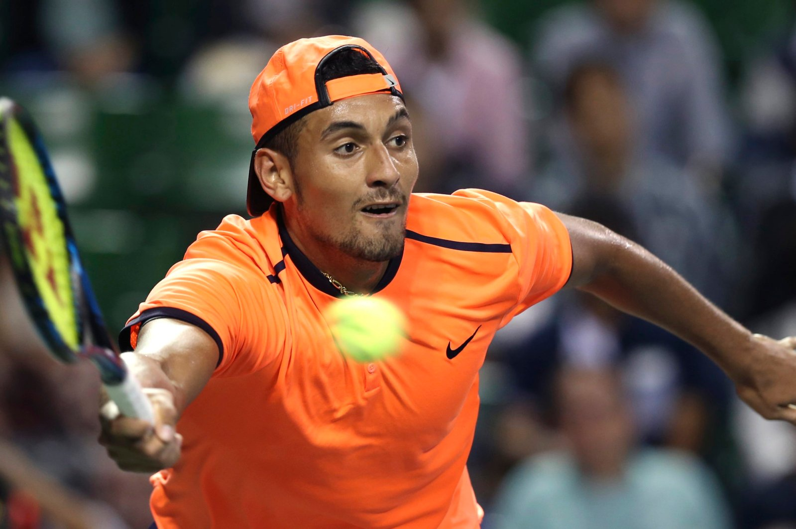 Nick Kyrgios returns a shot to Gael Monfils during the Japan Open, Oct. 8, 2016. (AP Photo)