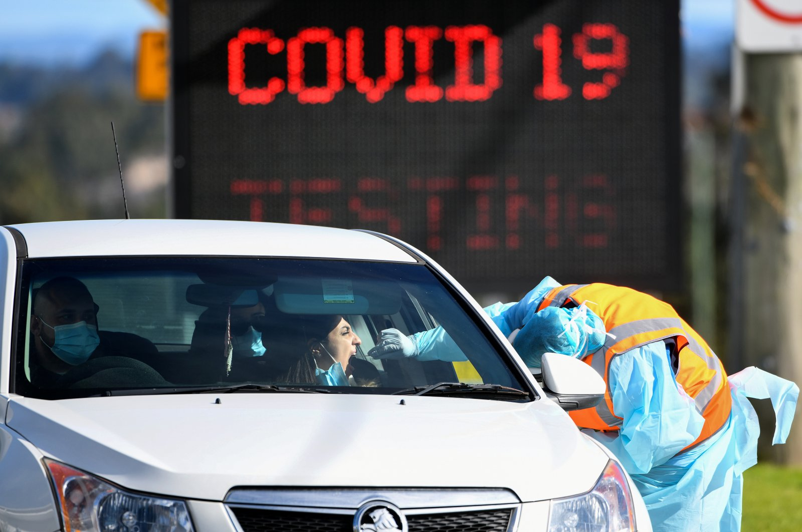 A member of the public is seen getting a test for the coronavirus disease (COVID-19) at the Crossroads Hotel testing centre following a cluster of infections in Sydney, Australia, July 16, 2020. (Reuters Photo)