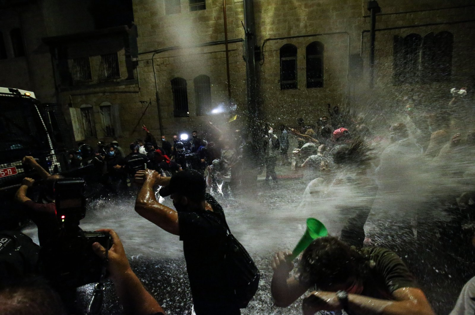 Israeli police use water cannons to disperse demonstrators protesting against the government response to the coronavirus pandemic in Jerusalem on July 18, 2020. (AA Photo)