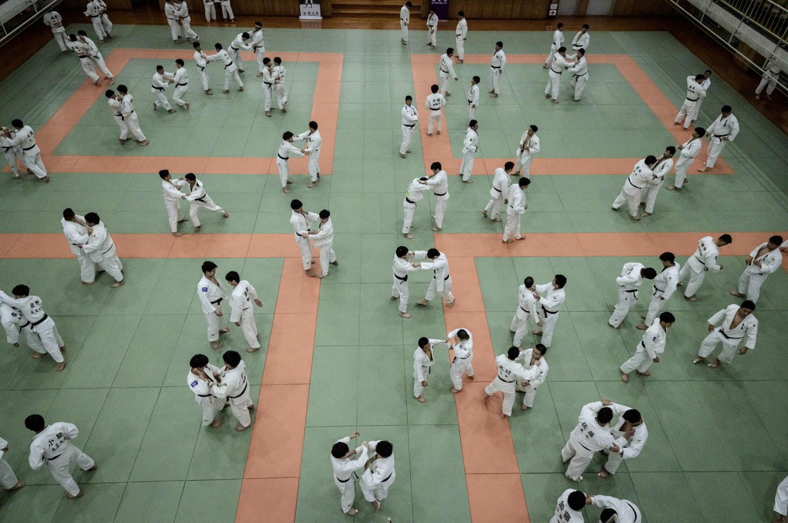 Judokas wrestle during a weekly freestyle practice session in Tokyo, Japan, Feb. 19, 2020. (AFP Photo)