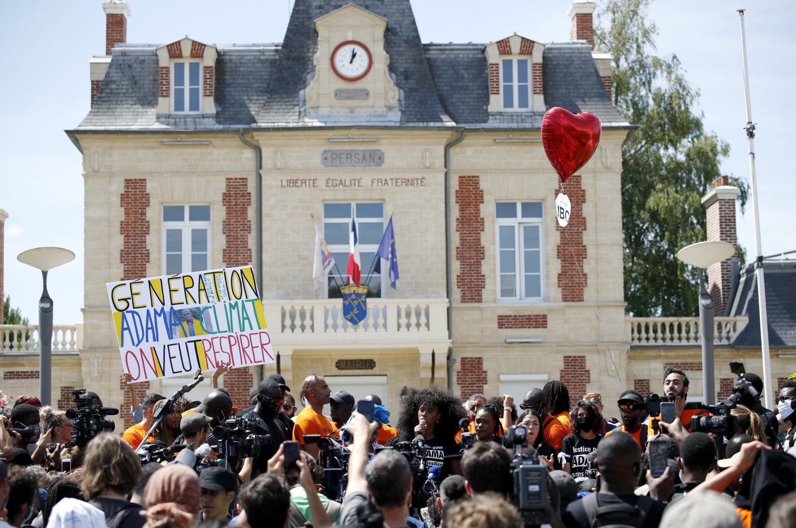 Assa Traore (C) delivers a speech prior to a demonstration against police brutality and racism in Beaumont-sur-Oise, near Paris, July, 18 2020. (EPA Photo)
