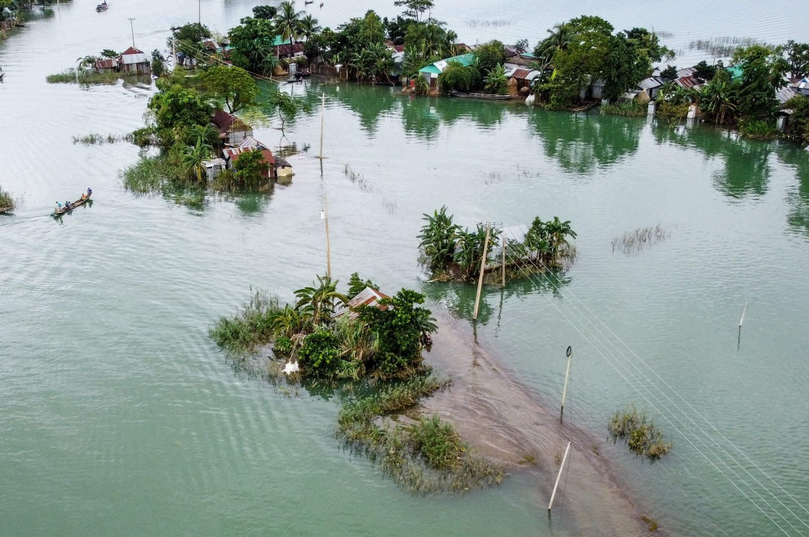 This aerial view shows flooded houses in Sunamganj, Bangladesh on July 15, 2020. (AFP Photo)