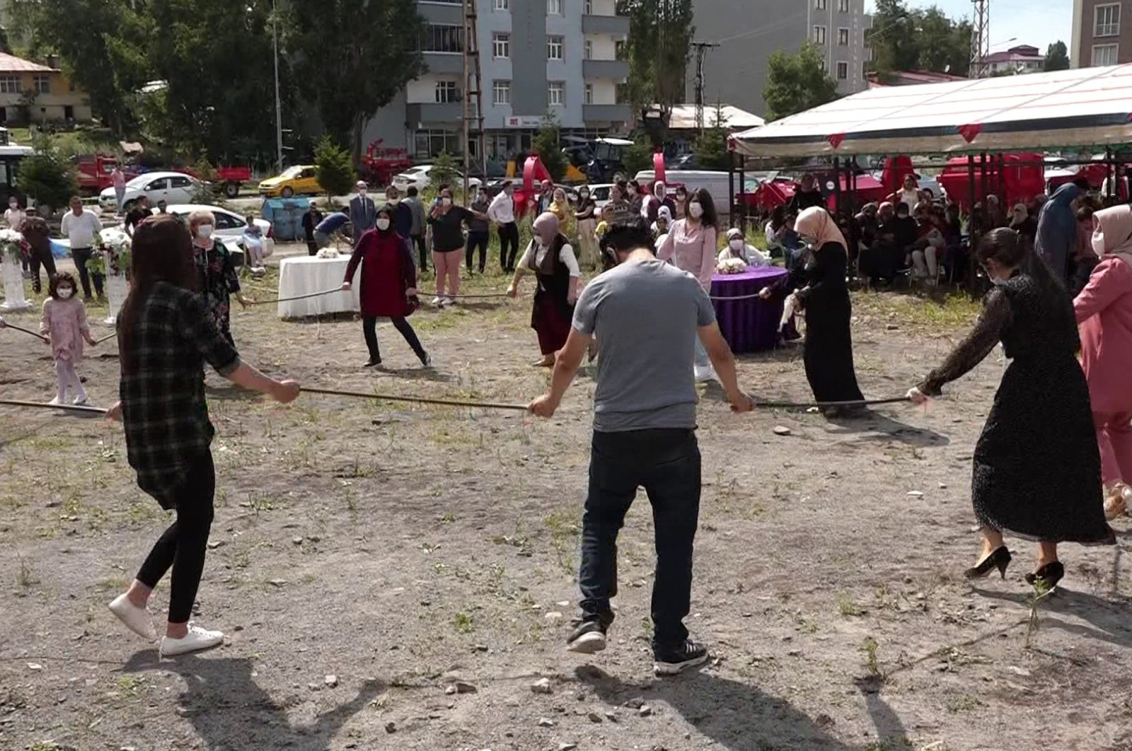 People use sticks instead of holding hands while performing folk dances due to COVID-19 measures in Ardahan, Turkey, July 19, 2020.