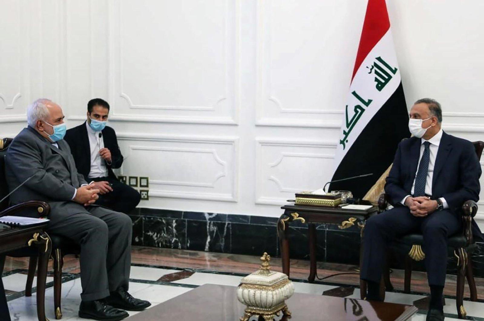 Iraqi Prime Minister Mustafa al-Kadhimi(L) meets with Iran's Foreign Minister Mohammad Javad Zarif, Baghdad, July 19, 2020. (AFP Photo)
