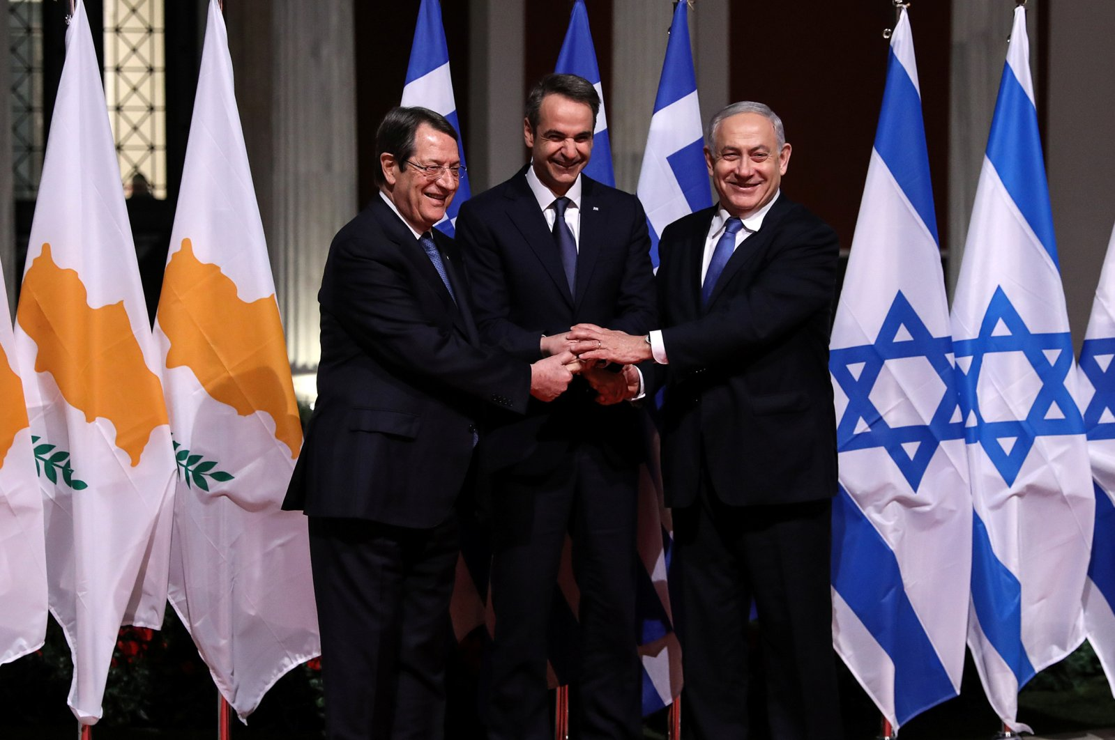 Greek Cypriot leader Nicos Anastasiades, Greek Prime Minister Kyriakos Mitsotakis and Israeli Prime Minister Benjamin Netanyahu pose for a photo before signing a deal to build the EastMed subsea pipeline to carry natural gas from the Eastern Mediterranean to Europe, at the Zappeion Hall in Athens, Greece, Jan. 2, 2020. (Reuters Photo)