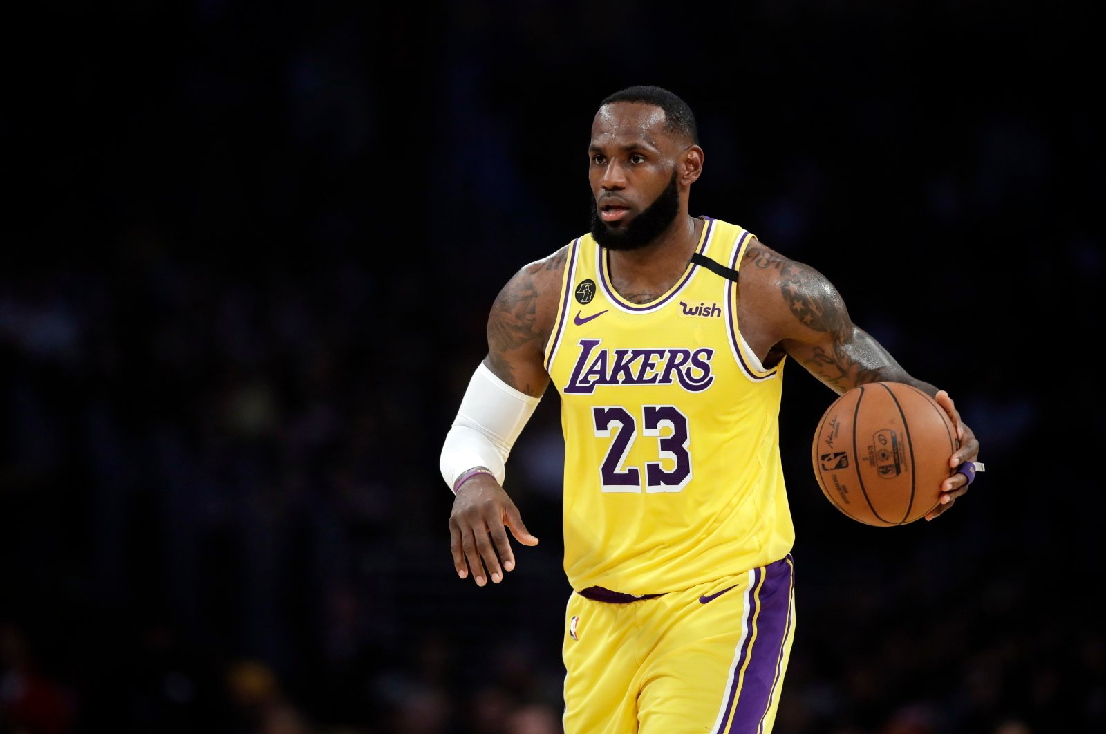 Los Angeles Lakers' LeBron James (23) dribbles during the first half of an NBA basketball game against the Brooklyn Nets in Los Angeles, California, U.S., March 10, 2020. (AP Photo)