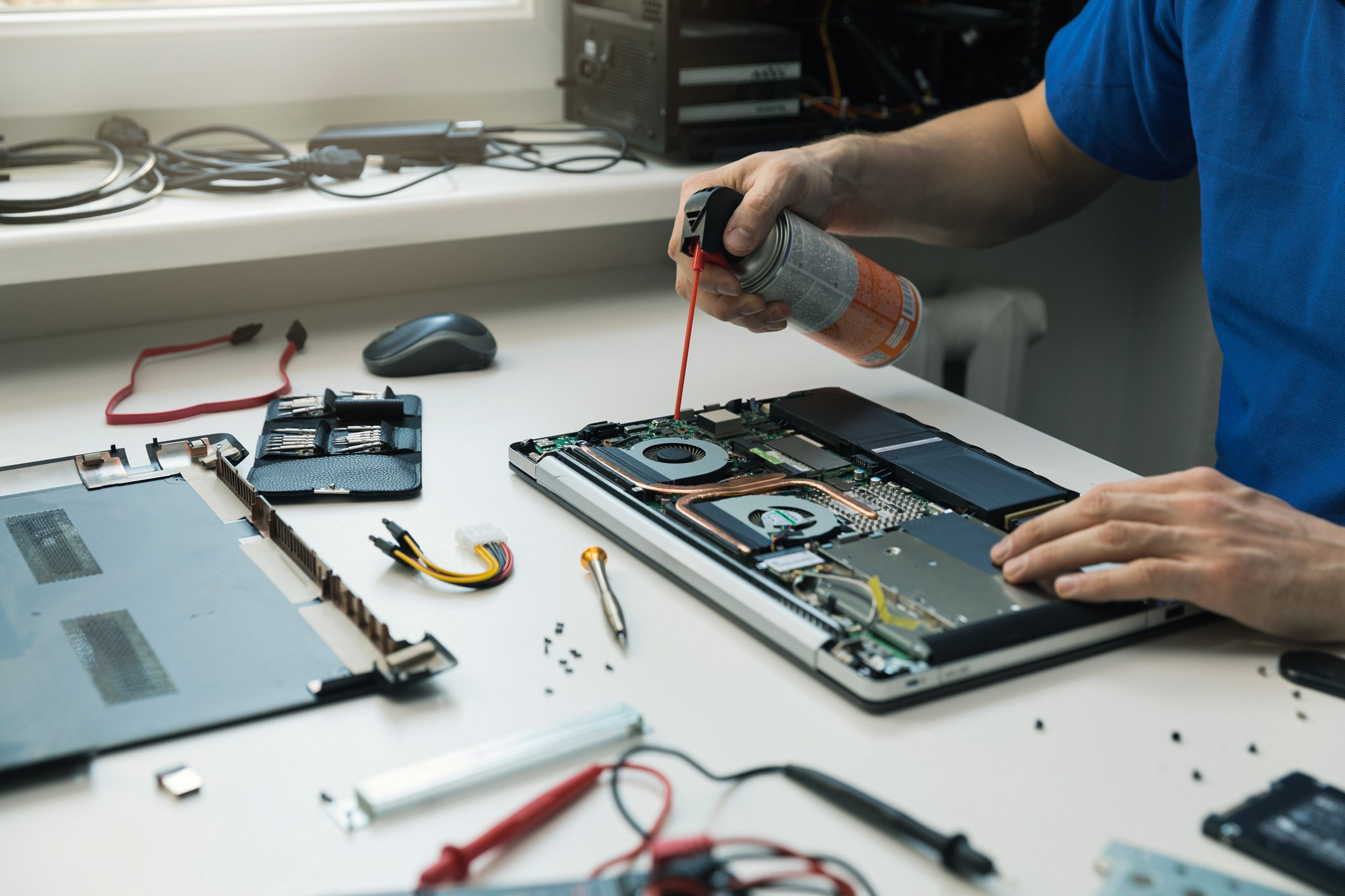 Using compressed air is a good way to get rid of the dust collected in your laptop's parts. (iStock Photo)