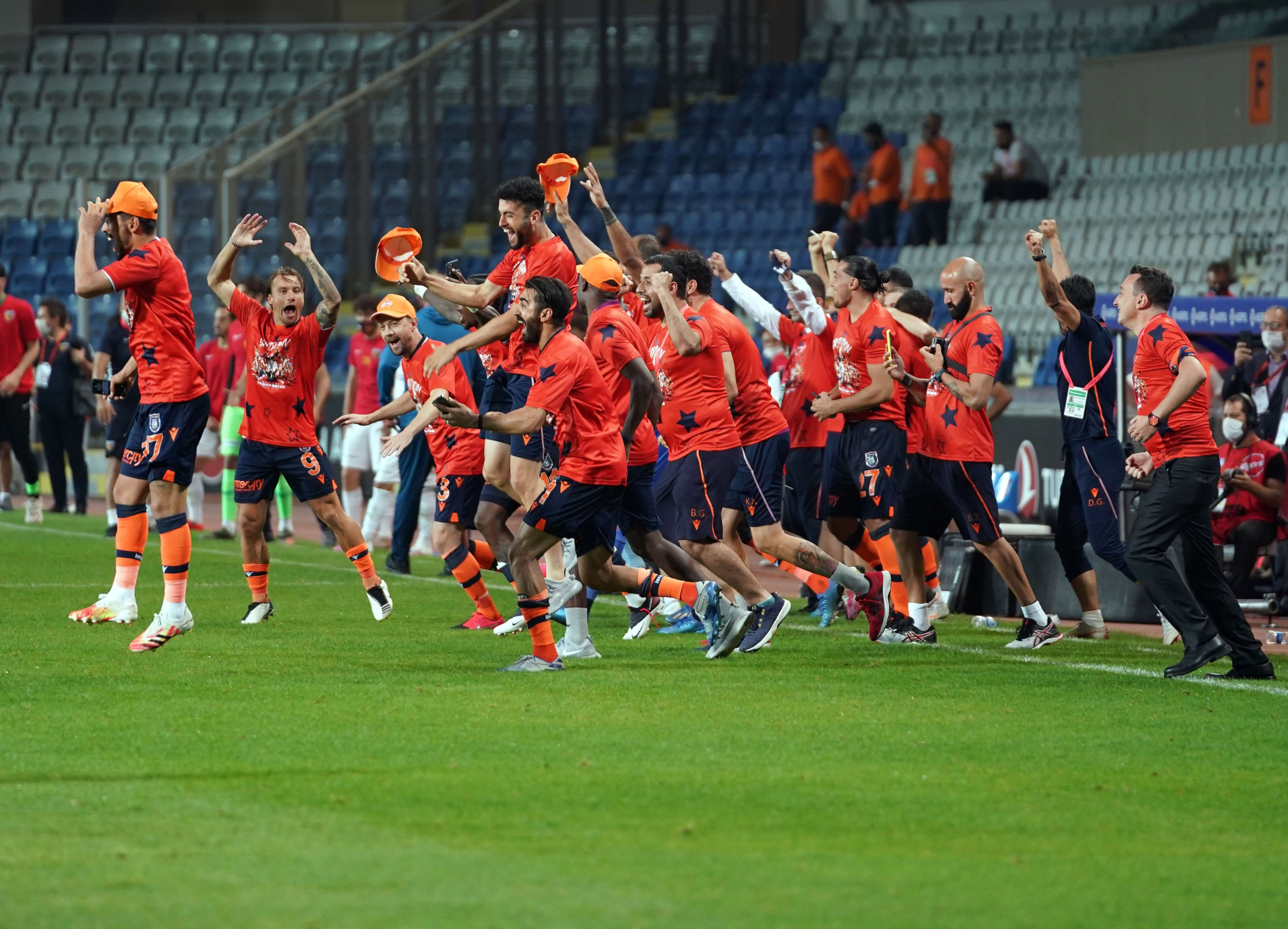 Başakşehir players rush on the pitch after they were declared Süper Lig champions, Istanbul, Turkey, July 19, 2020. (IHA Photo)