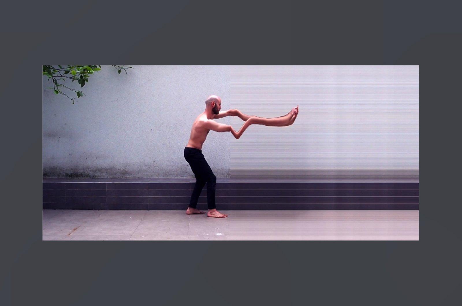 """A still shot from Balkan Karışman, """"through the slit,"""" video, 4m36s, 2020."""