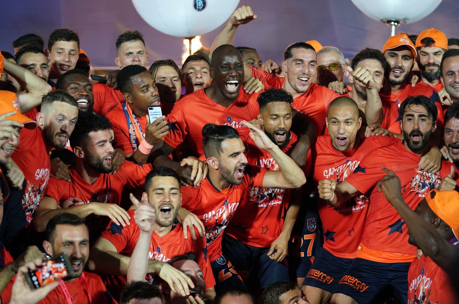 Başakşehir pose for a photo after winning the Turkish Süper Lig, Istanbul, Turkey, July 19, 2020. (IHA Photo)