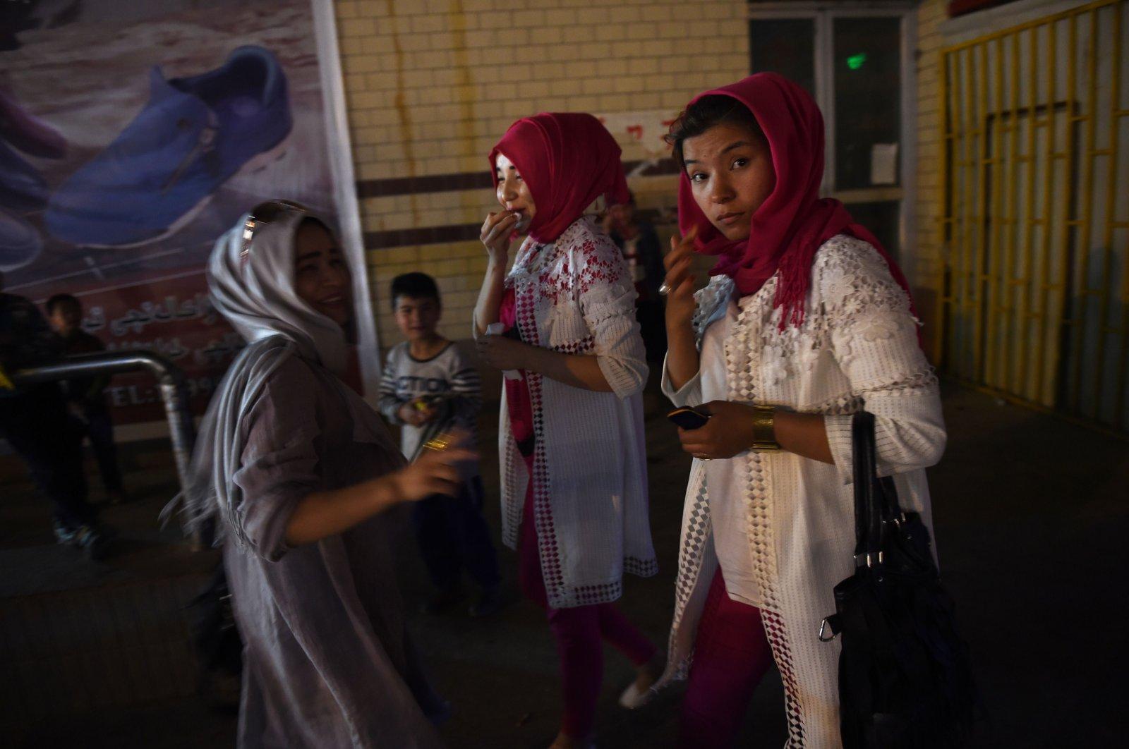 Uighur women at a market in China's western Xinjiang region, April 16, 2015. (AFP Photo)