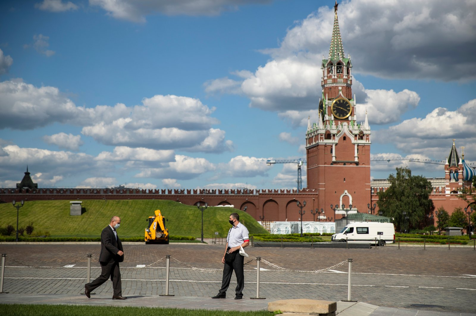 A Russian Federal Guard Service (FSO) officer (C) stands guard at the Kremlin with the Spasskaya Tower in the background, Moscow, Russia, July 10, 2020. (AP Photo)