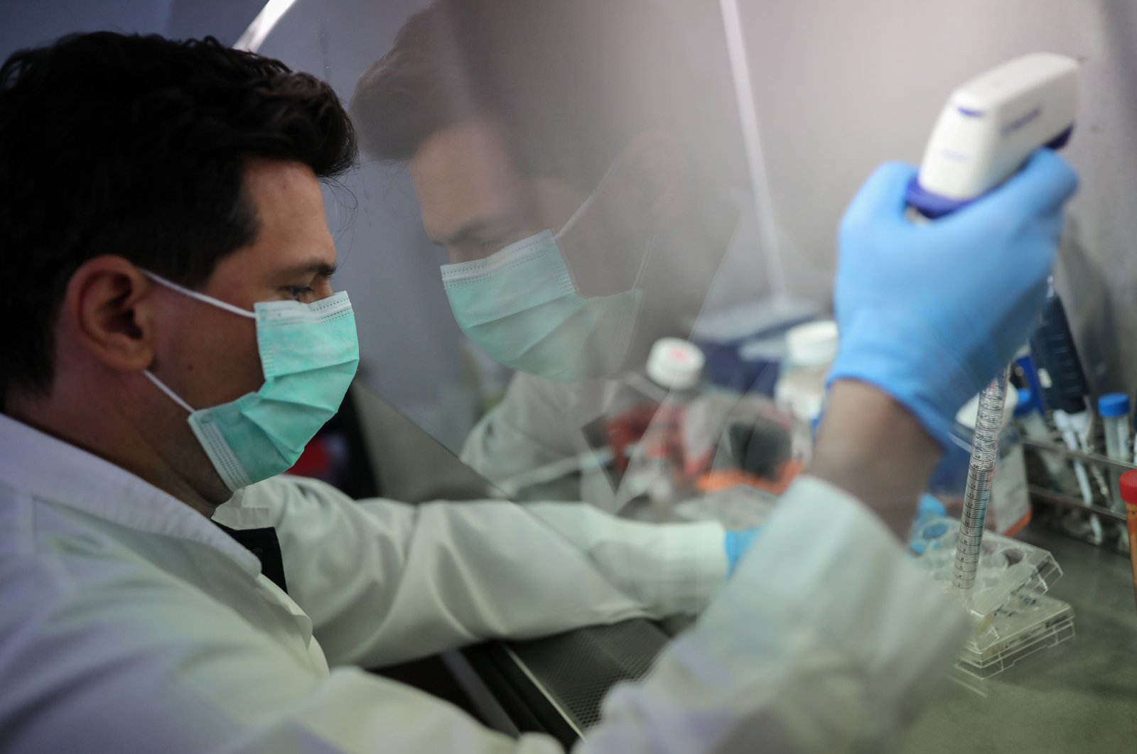 A scientist works on cells that produce antibodies against COVID-19 in a university lab in Athens, Greece, July 8, 2020. (Reuters Photo)