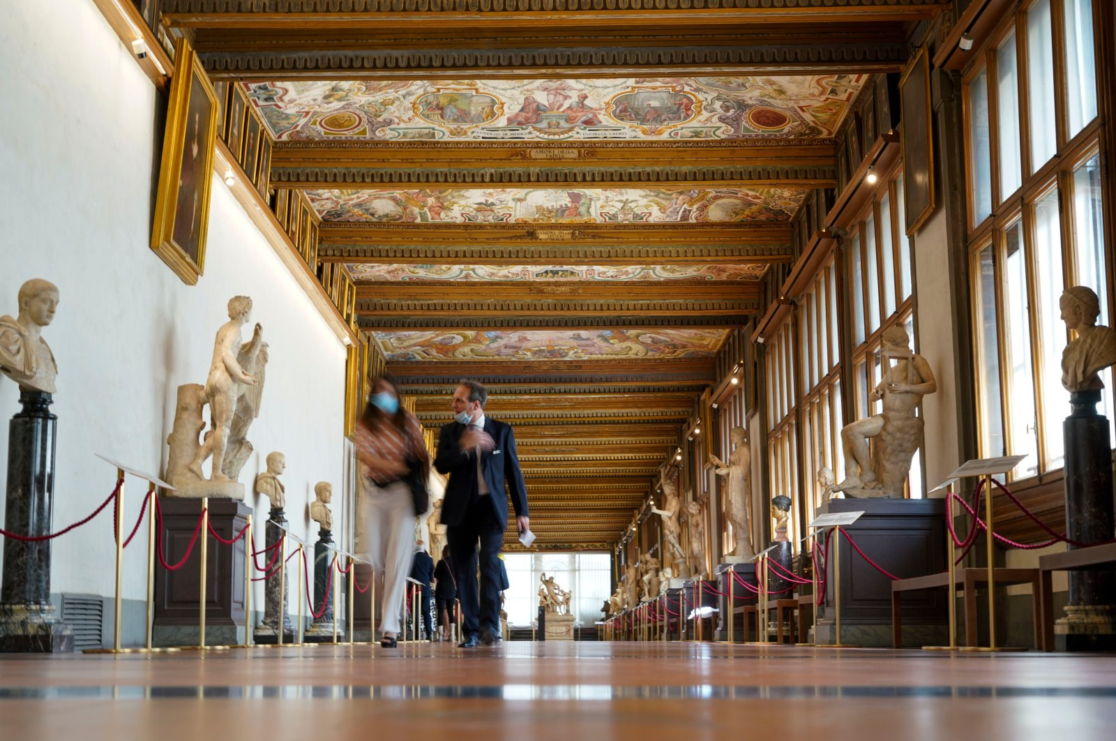 People walk in the Uffizi Gallery during a press tour on the reopening day of the museum, in Florence, Italy, June 3, 2020. (AP Photo)