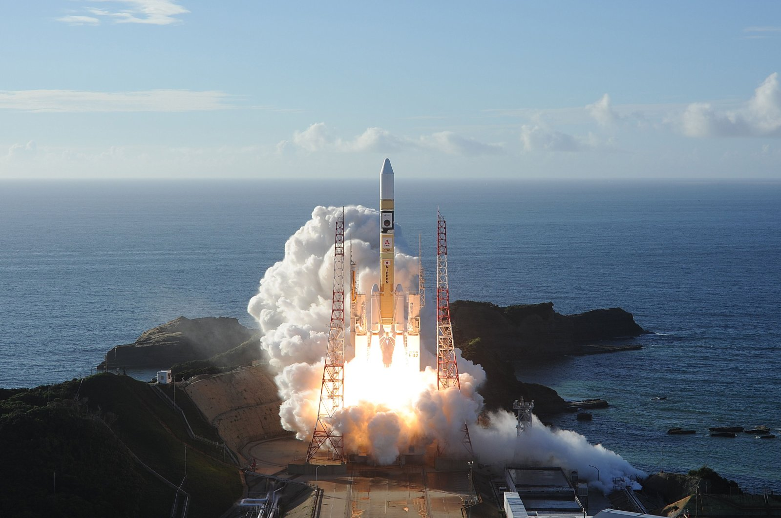 """In this handout photograph taken and released on July 20, 2020 by Mitsubishi Heavy Industries an H-2A rocket carrying the Hope Probe known as """"Al-Amal"""" in Arabic, developed by the Mohammed Bin Rashid Space Centre (MBRSC) in UAE to explore Mars, blasts off from Tanegashima Space Centre in southwestern Japan. (Mitsubishi Heavy Industries / AFP Photo)"""