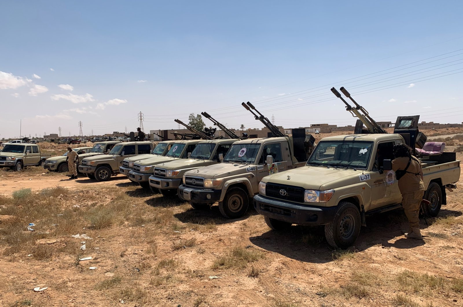 Troops loyal to Libya's internationally recognized government are seen in military vehicles as they prepare before heading to Sirte, on the outskirts of Misrata, Libya, July 18, 2020. (REUTERS Photo)