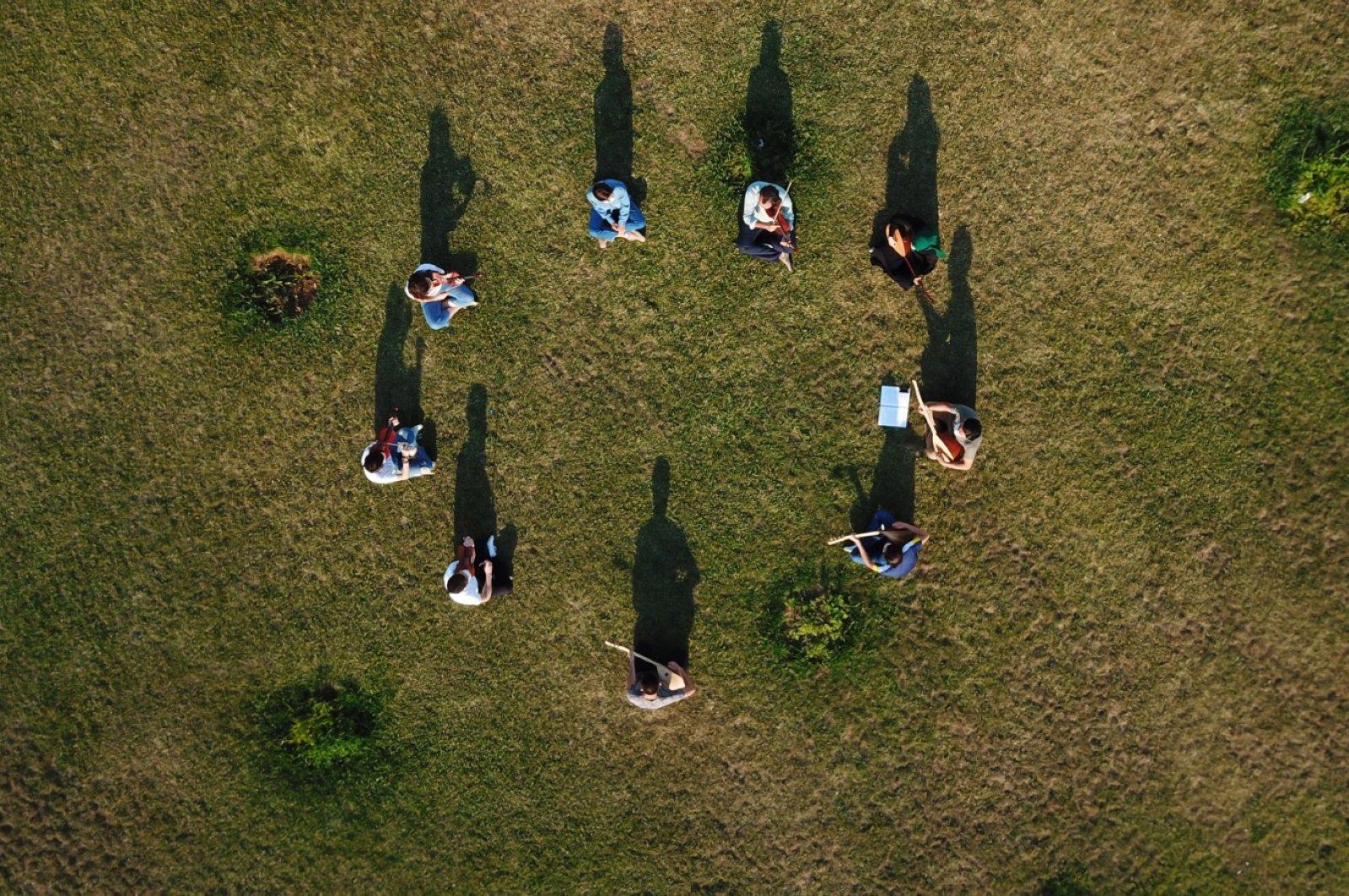 Başakşehir Music Academy students attend a socially distanced outdoor lesson, Başakşehir district, Istanbul, Turkey, July 18, 2020. (DHA Photo)